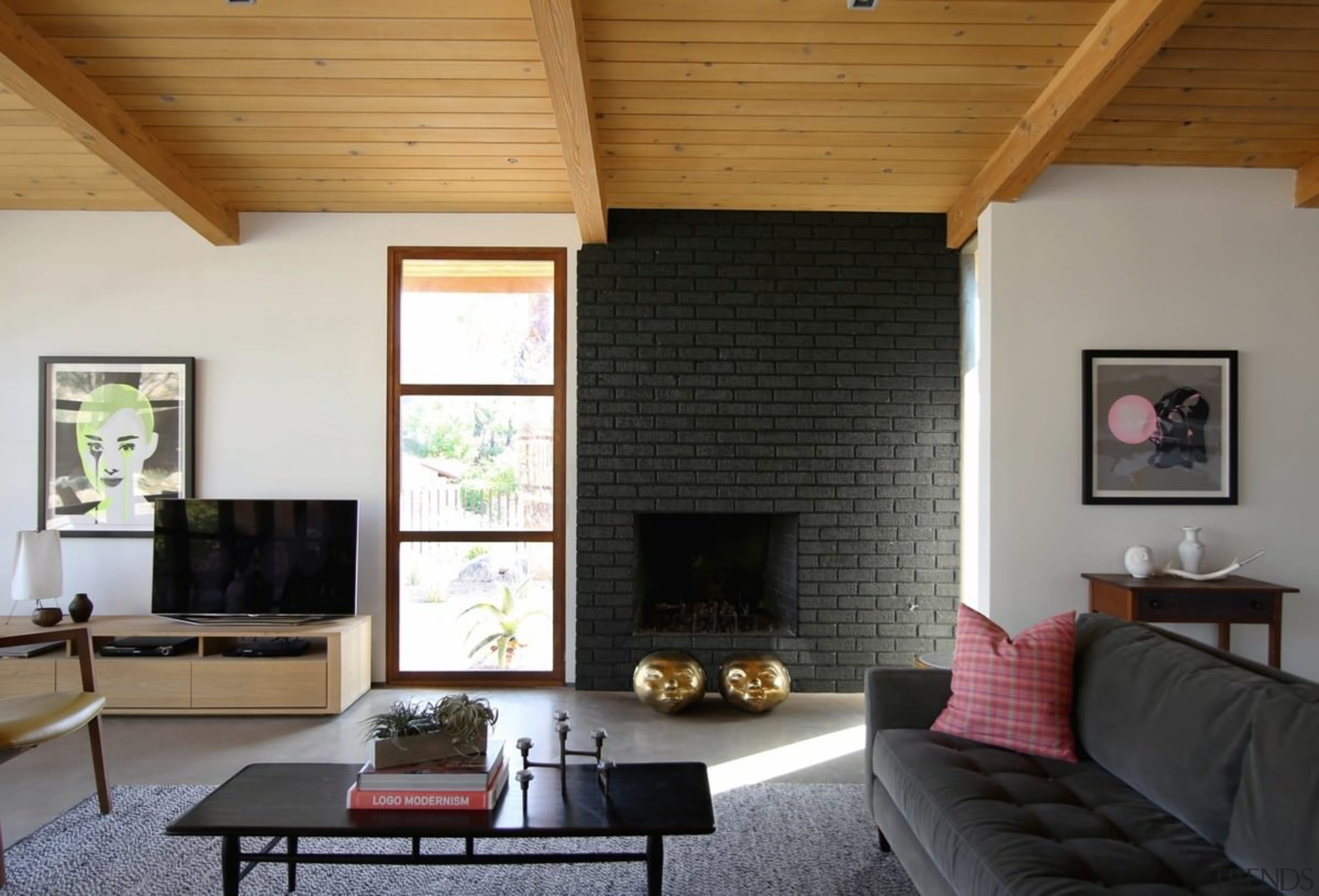 The fireplace is surrounded with black brick - architecture, ceiling, daylighting, fireplace, floor, hardwood, hearth, home, house, interior design, living room, real estate, room, wall, window, wood, wood flooring, black