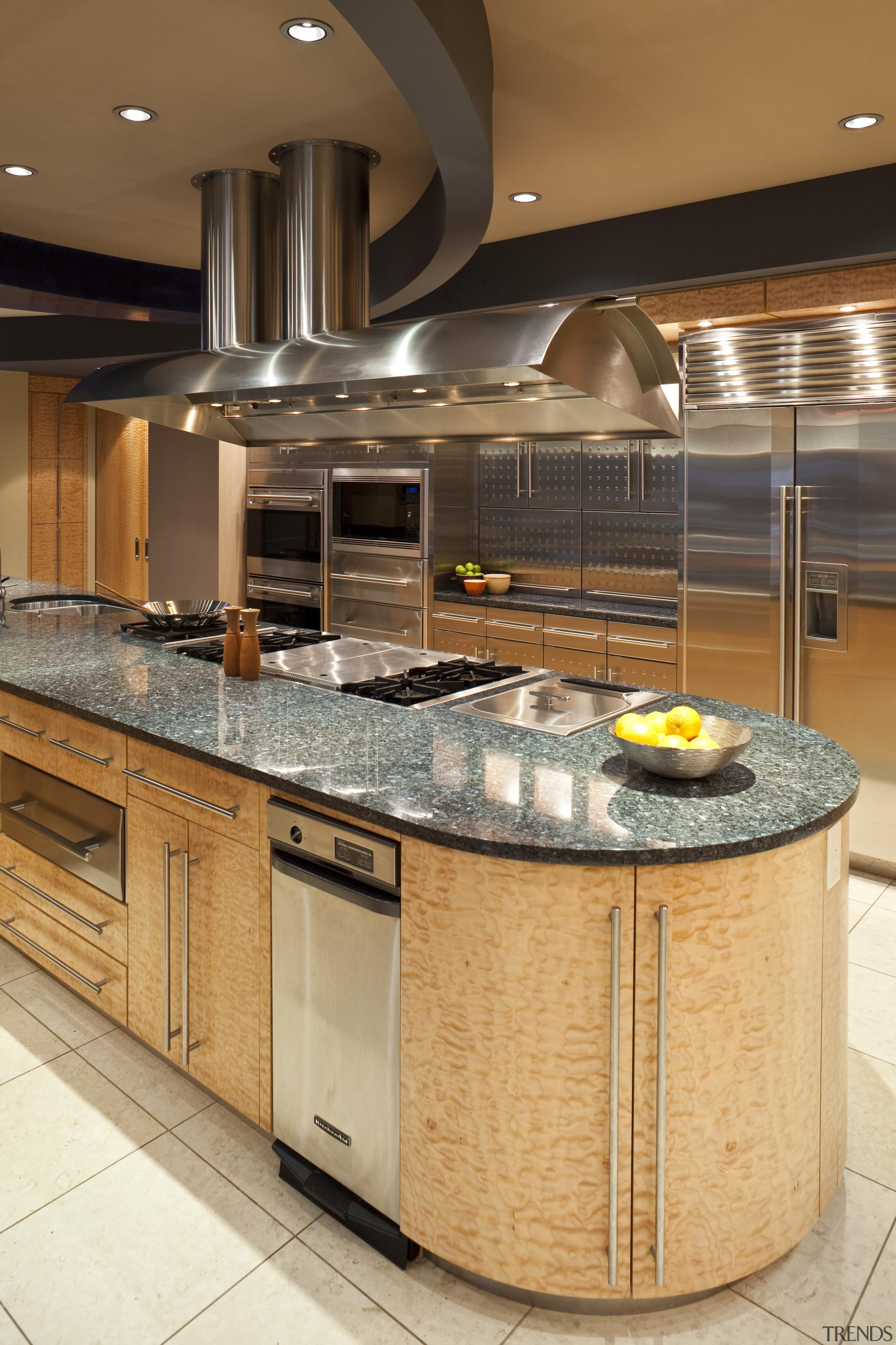View of a kitchen which features a granite cabinetry, countertop, cuisine classique, interior design, kitchen, orange, brown