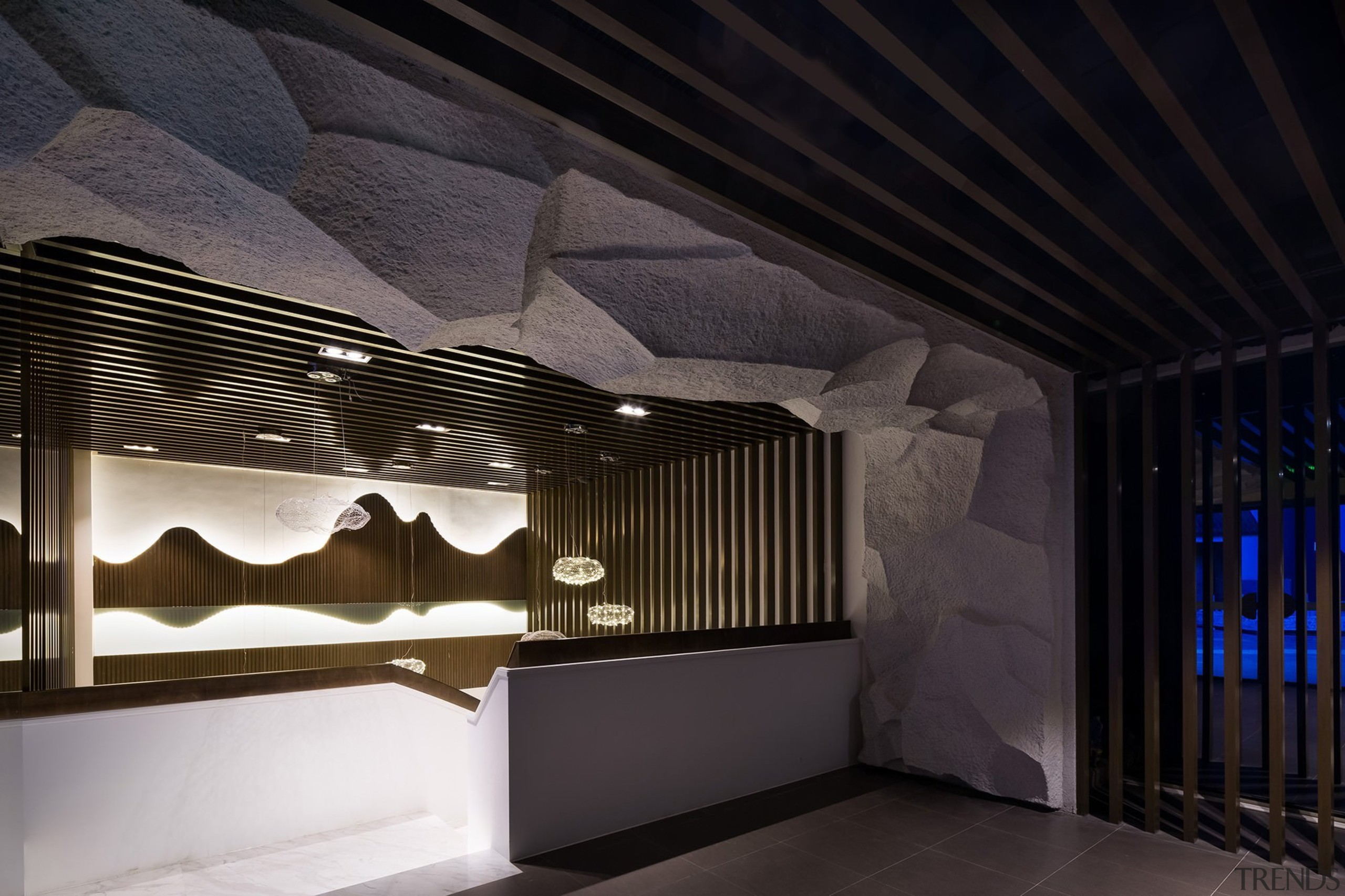 The rock runs up the wall and across architecture, ceiling, daylighting, interior design, light, lighting, structure, tourist attraction, black