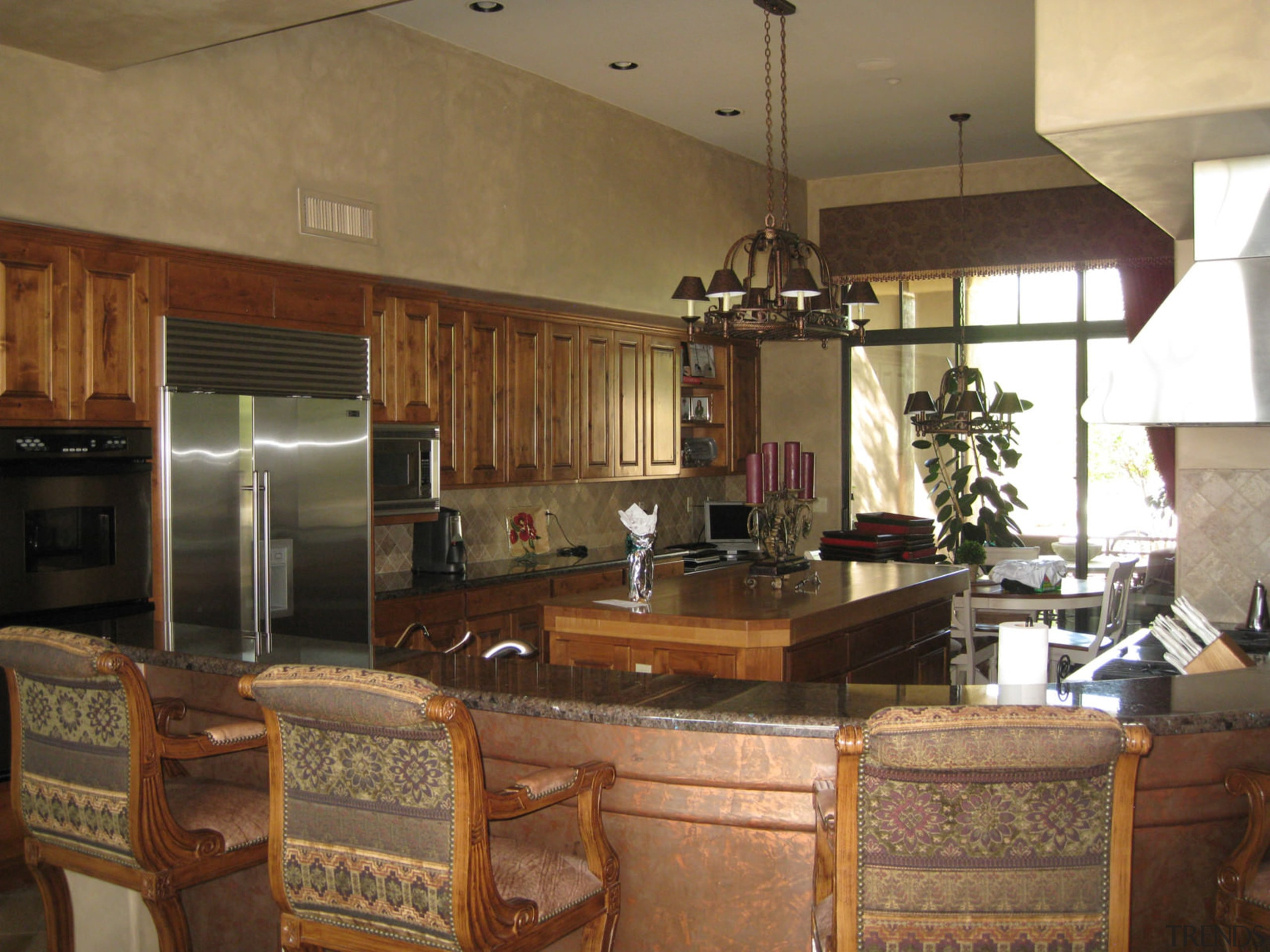 Dated wood cabinets and a brown colour scheme countertop, interior design, kitchen, living room, real estate, room, brown