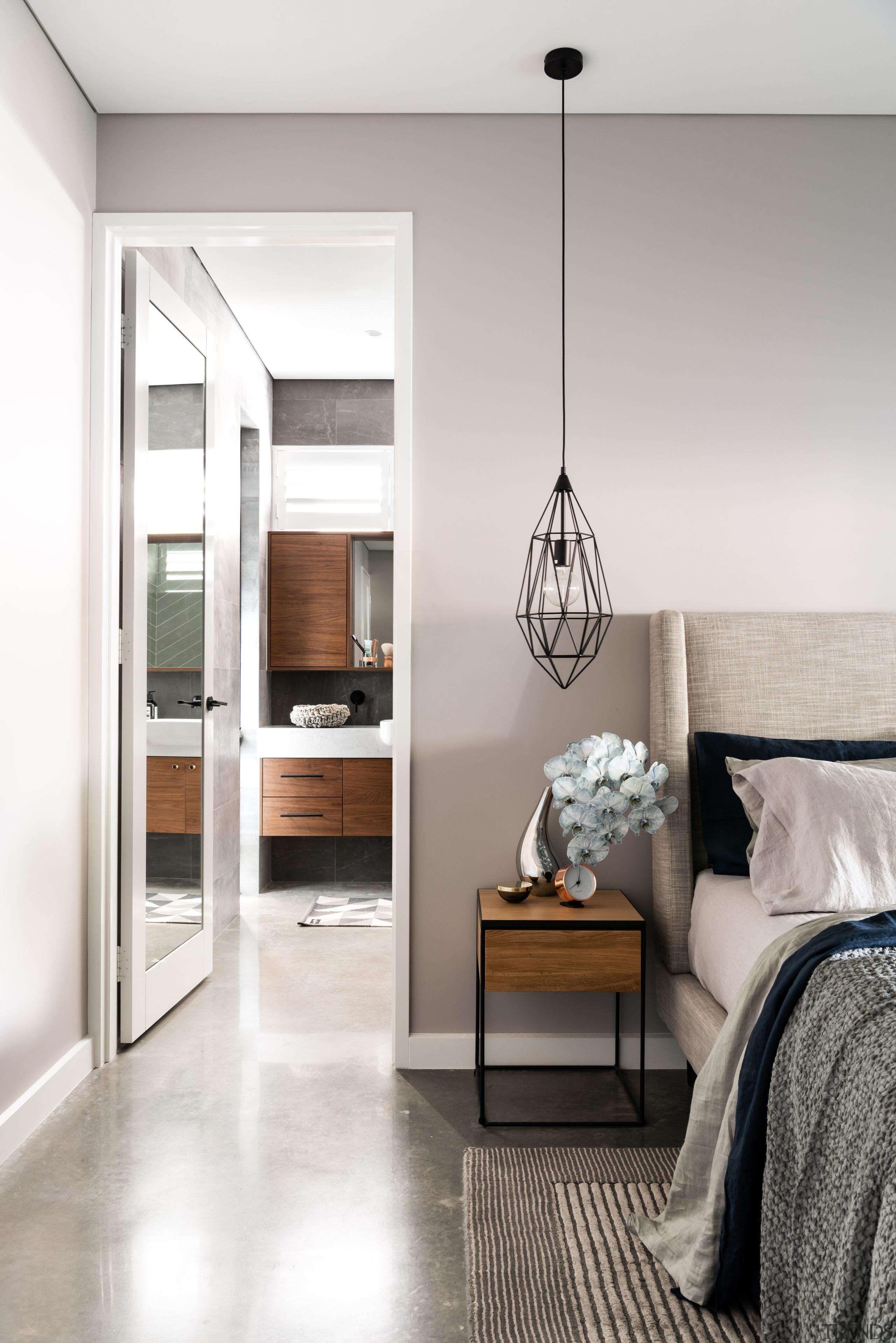 Pale wall and floor tones let the timber bed, bedroom, beige, floor, flooring, furniture, home, house, interior design, concrete flooring, light fixture, lighting, bedroom, table, wood, Dalecki Design