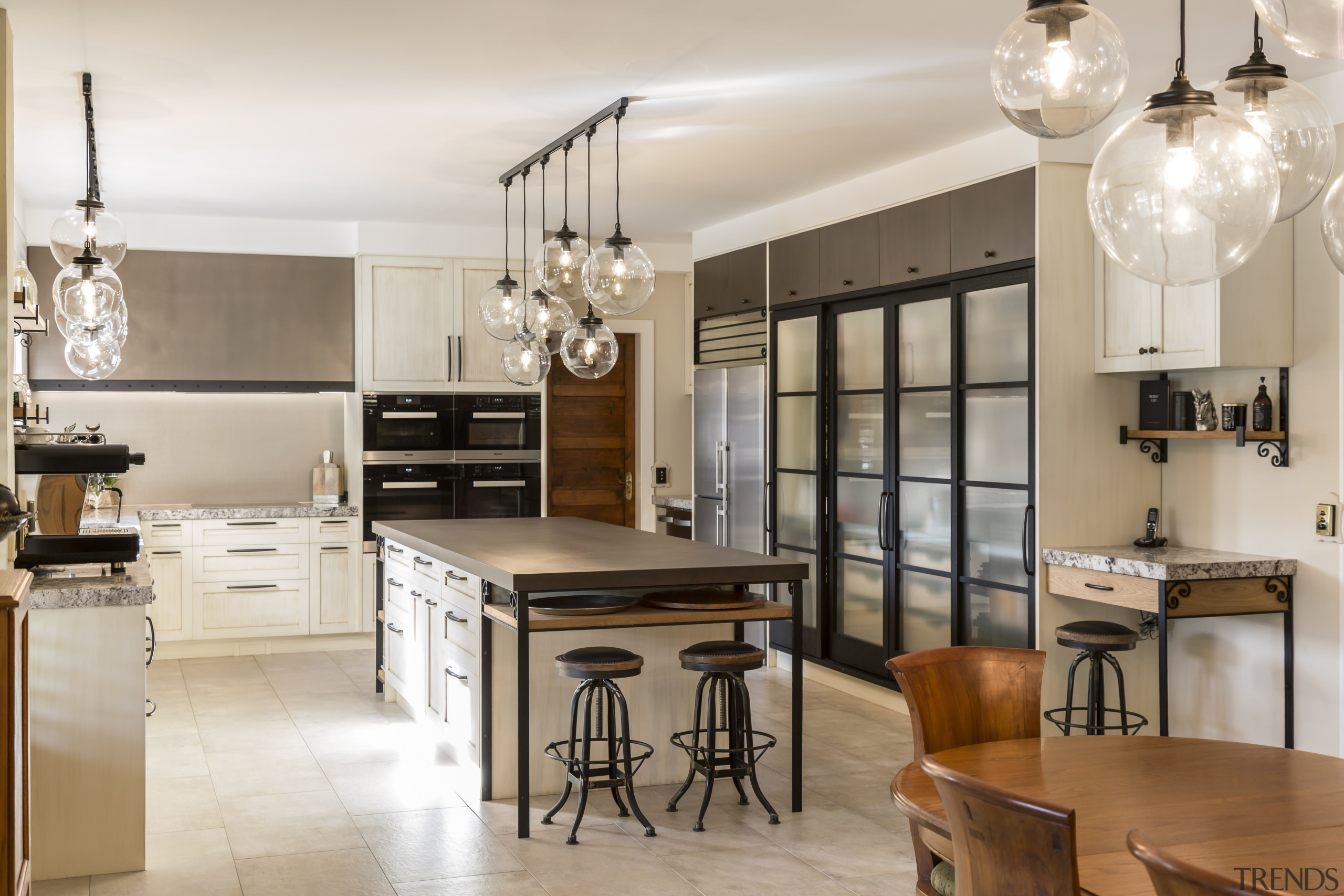 This renovated kitchens large central island includes storage cabinetry, countertop, cuisine classique, interior design, kitchen, room, white
