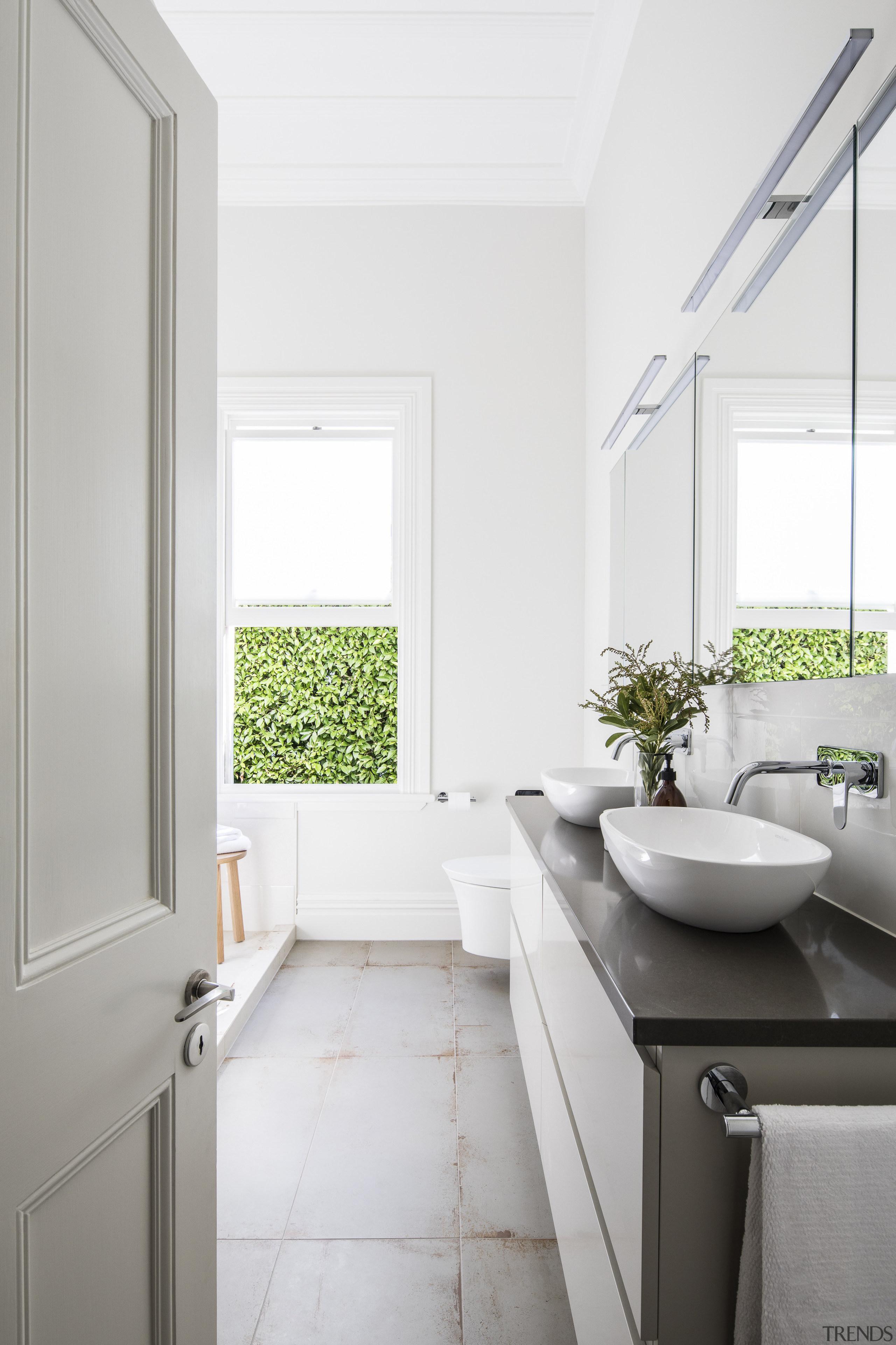 Even from the door, the play between contemporary architecture, bathroom, bathroom accessory, daylighting, floor, home, house, interior design, plumbing fixture, room, sink, tap, window, white