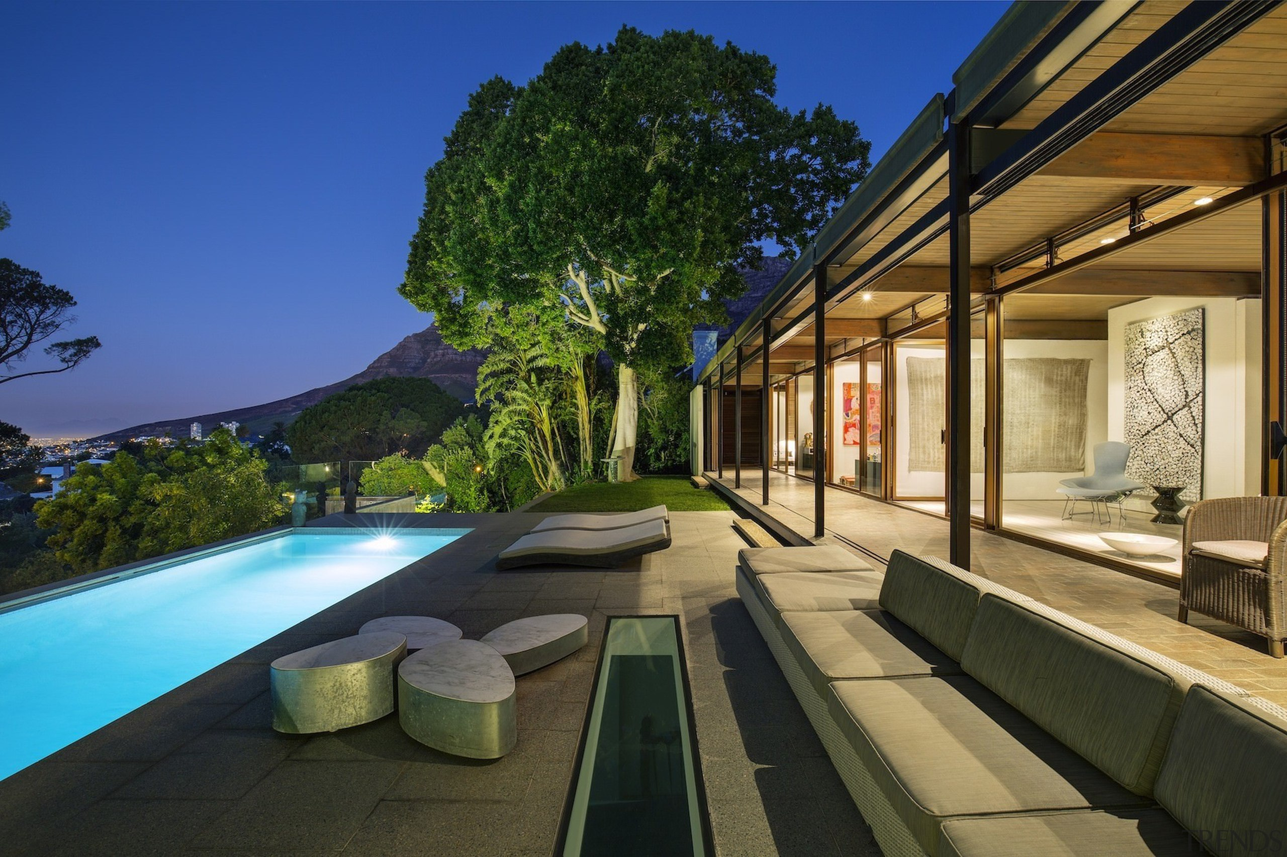 At night, the home has picturesque views down architecture, estate, home, house, leisure, property, real estate, resort, swimming pool, villa, brown