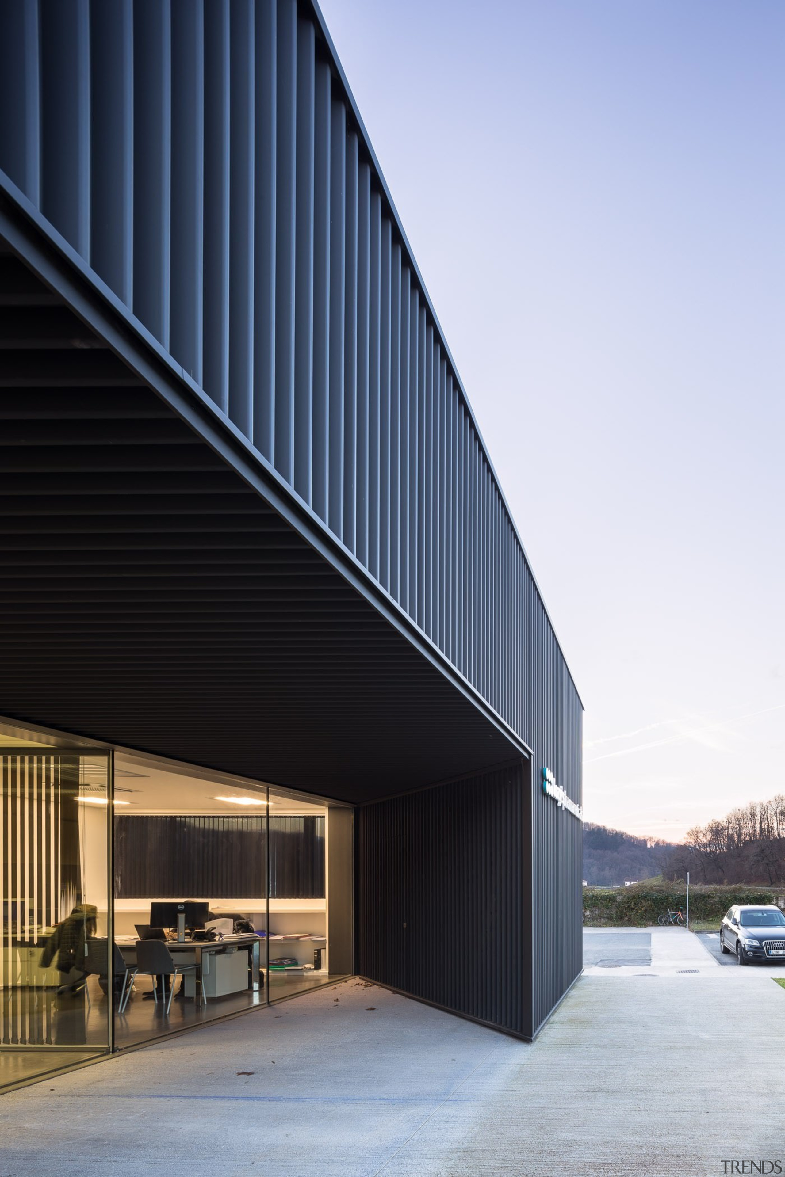 The angle of this wall means privacy for architecture, building, commercial building, corporate headquarters, facade, headquarters, house, siding, sky, structure, white, black
