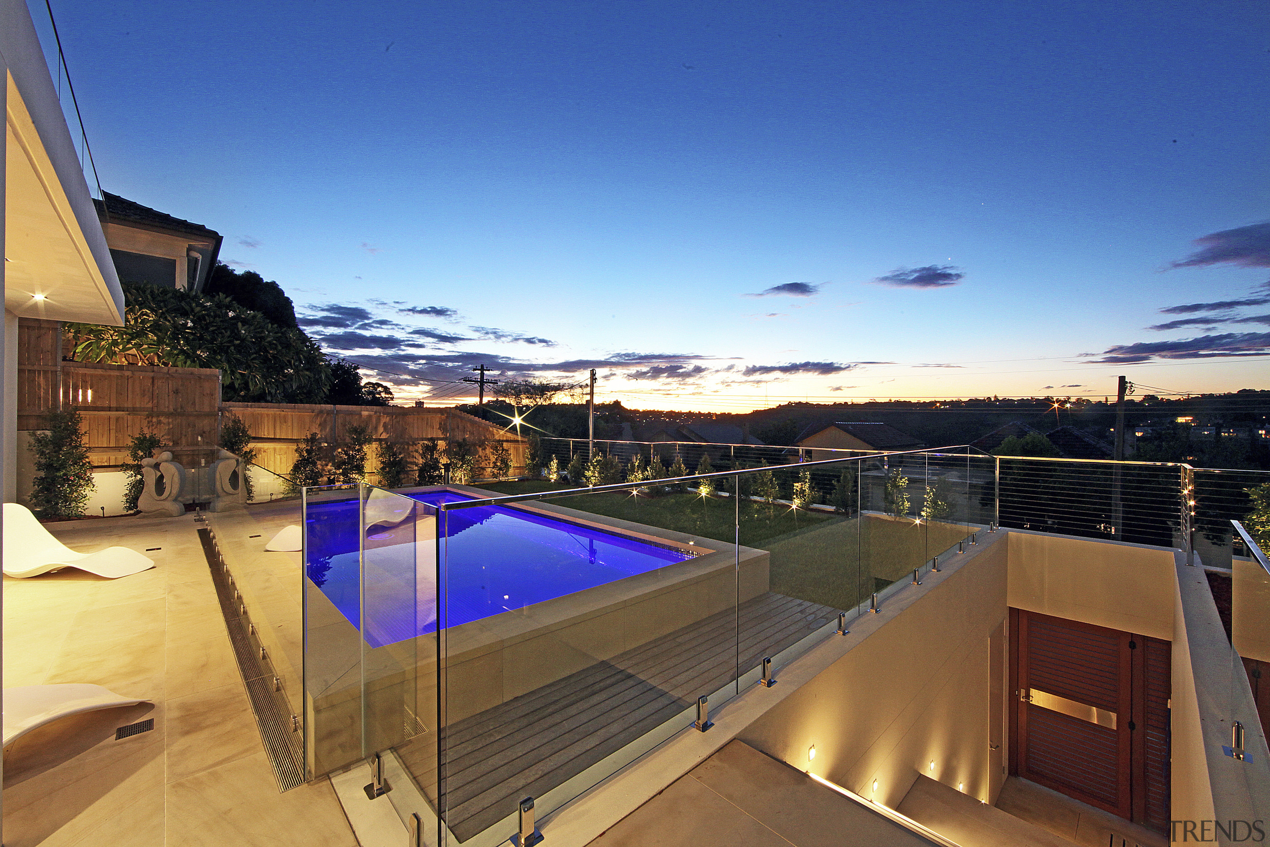 View from balcony to pool at dusk. - apartment, architecture, condominium, estate, home, house, penthouse apartment, property, real estate, roof, sky, swimming pool, villa