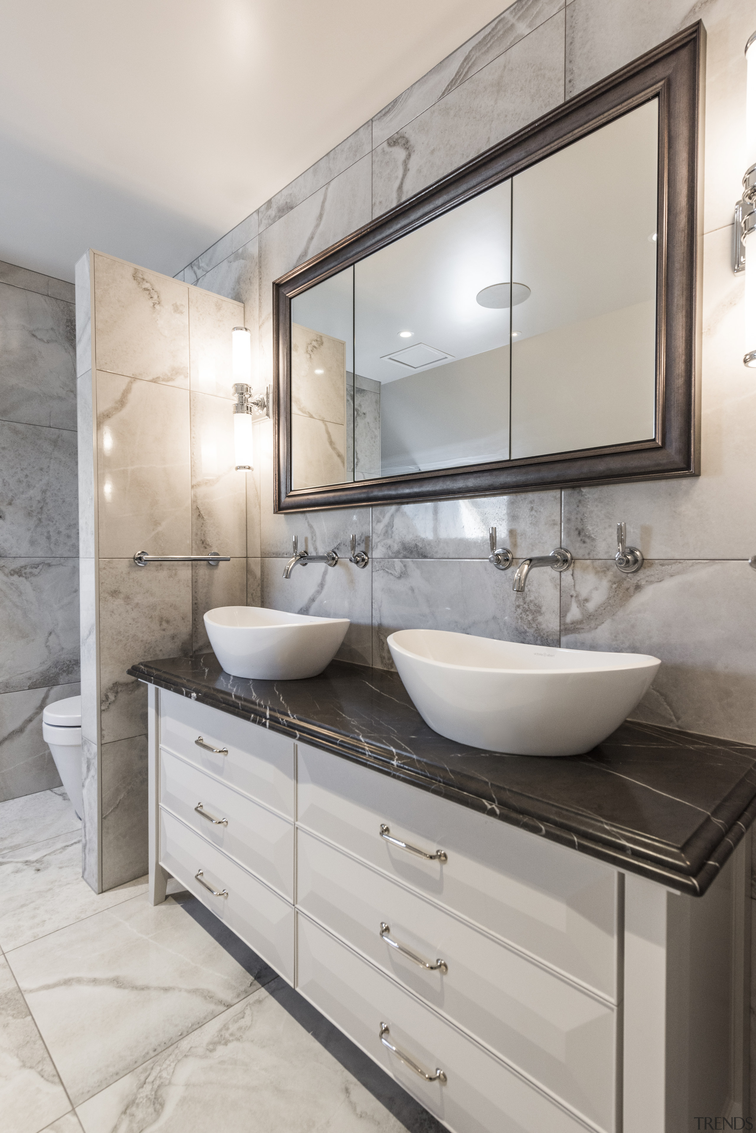 The natural stone vanity top provides a stunning architecture, bathroom, bathroom accessory, bathroom cabinet, building, cabinetry, ceiling, countertop, floor, flooring, furniture, home, house, interior design, marble, material property, plumbing fixture, property, real estate, room, sink, tap, tile, wall, gray