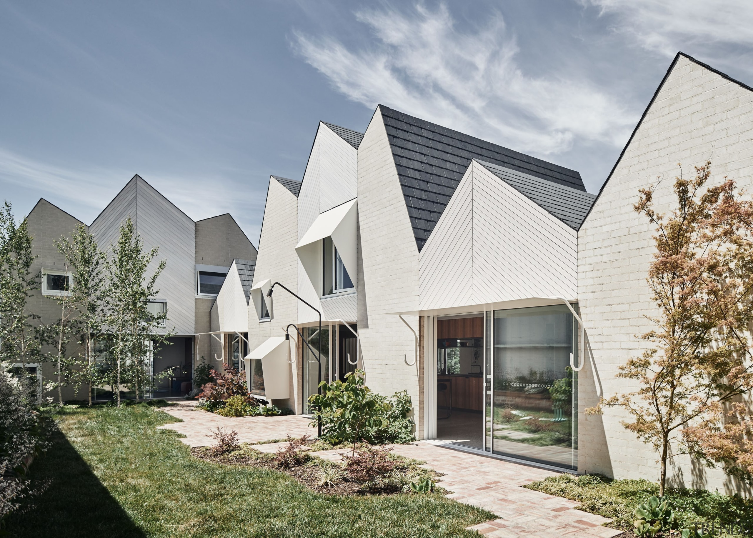 RaeRae's mountain roof form is shaped through context gray, white
