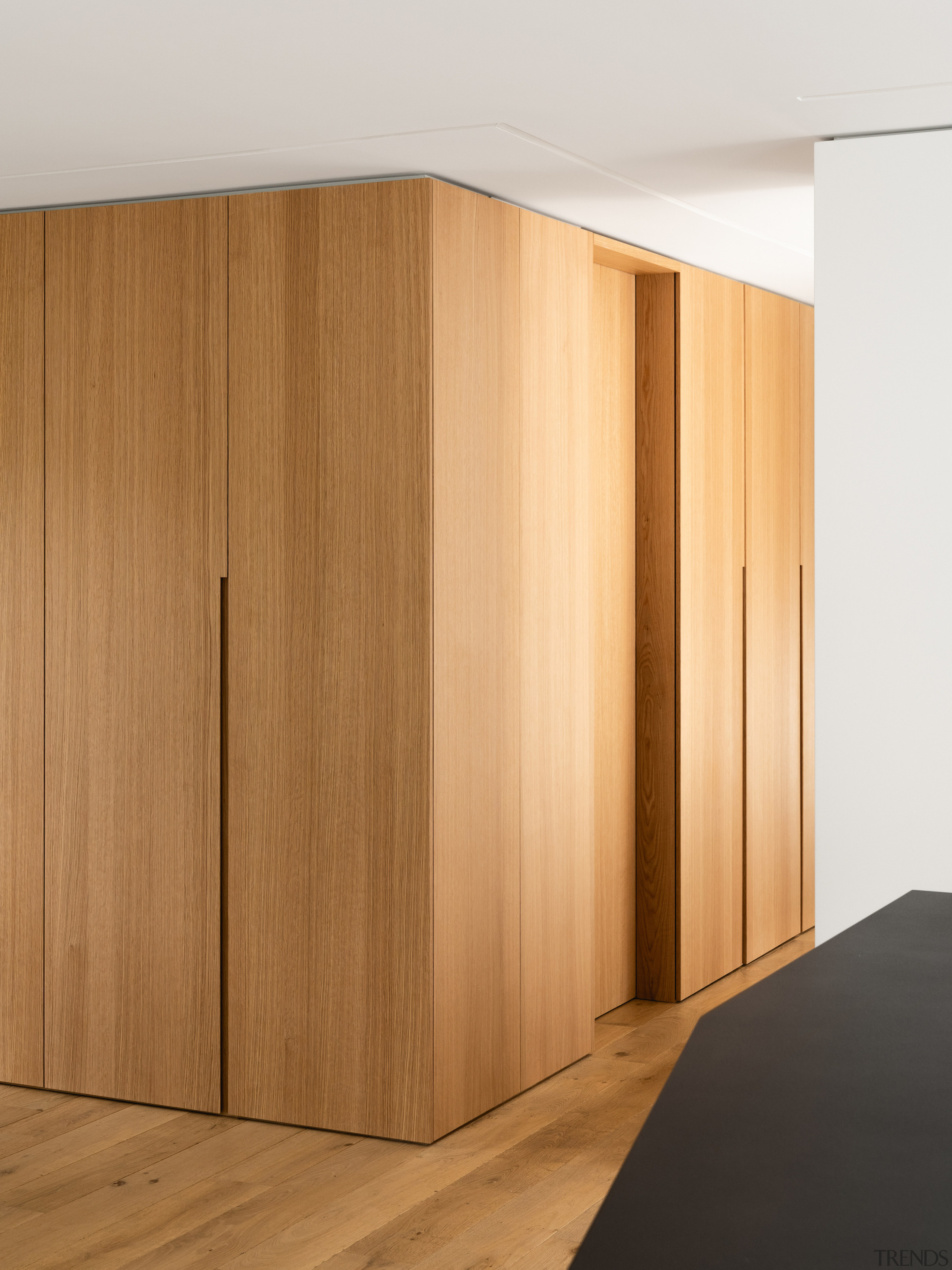 Clean-lined, custom wood joinery in this renovation serves