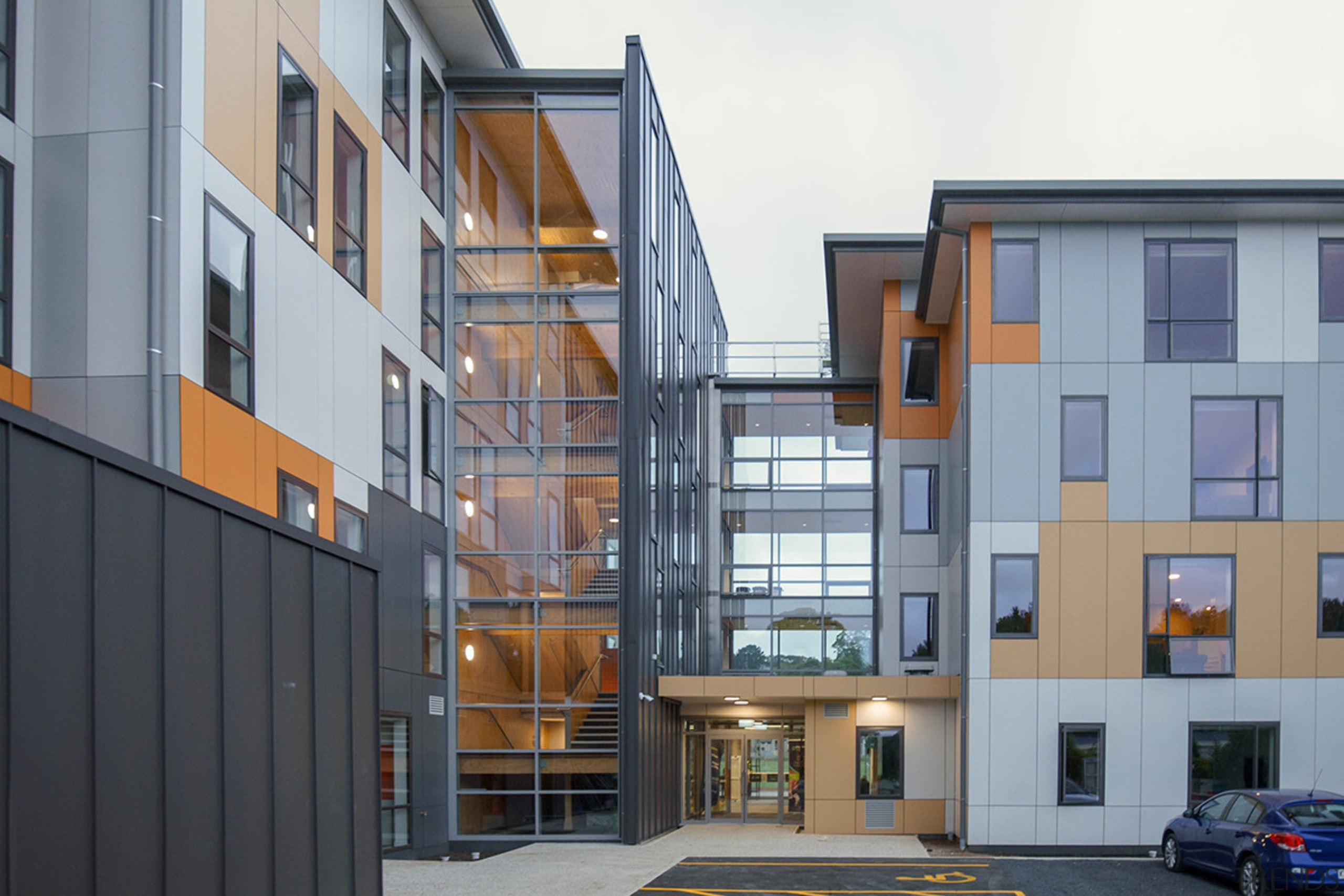 Otago Polytechnic Student Village includes a light-filled glass apartment, architecture, building, commercial building, condominium, elevation, facade, home, house, mixed use, neighbourhood, real estate, residential area, window, gray