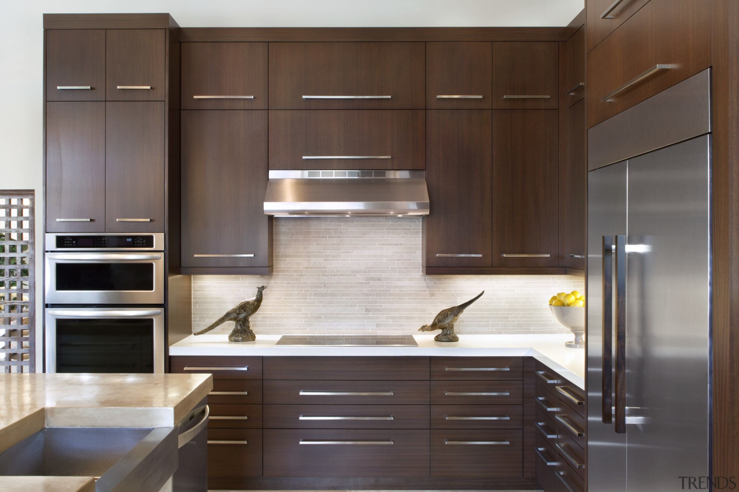 The splashback in this remodelled kitchen features light-toned cabinetry, countertop, cuisine classique, furniture, hardwood, interior design, kitchen, room, wood, brown, gray