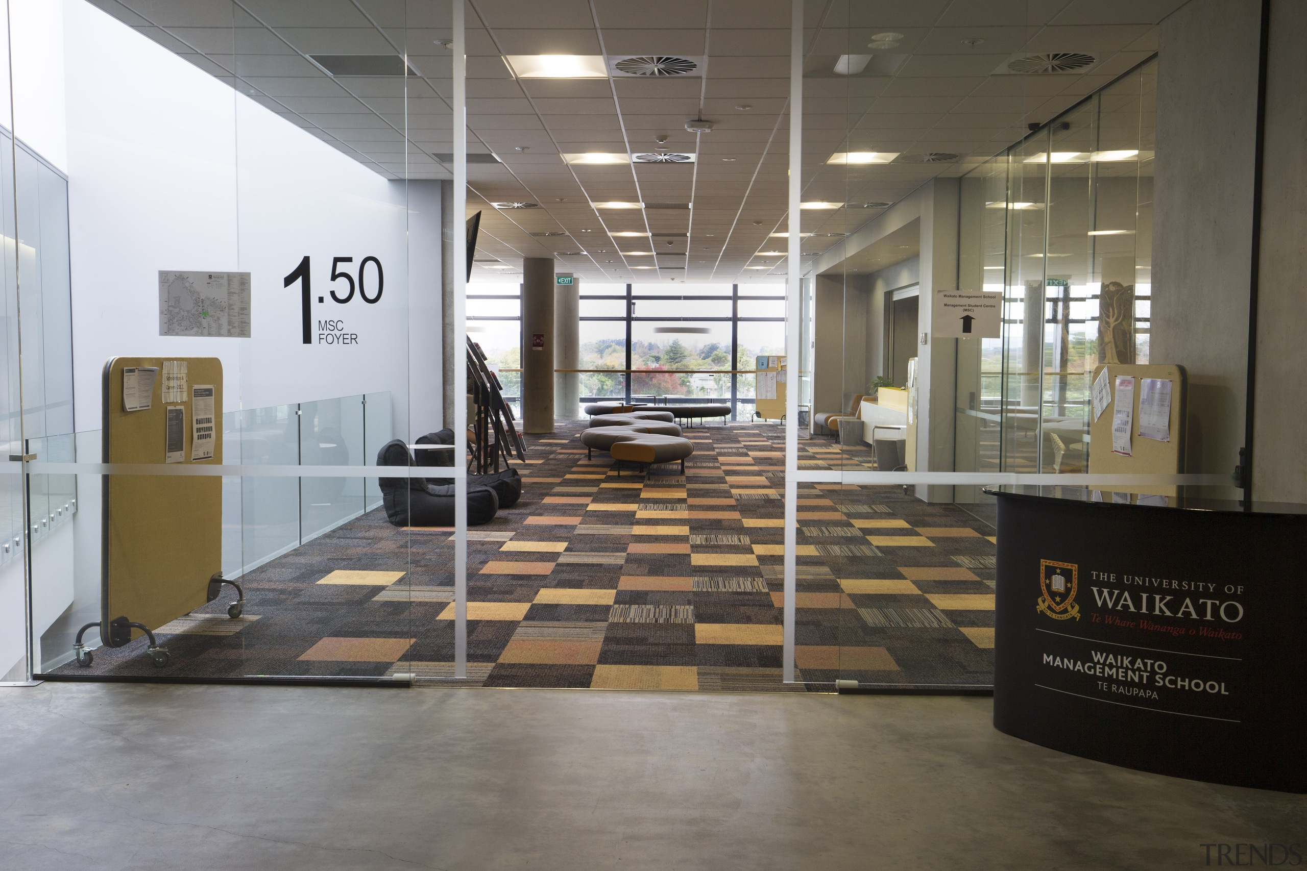 A long look out from the podium section exhibition, floor, flooring, interior design, lobby, tile, gray
