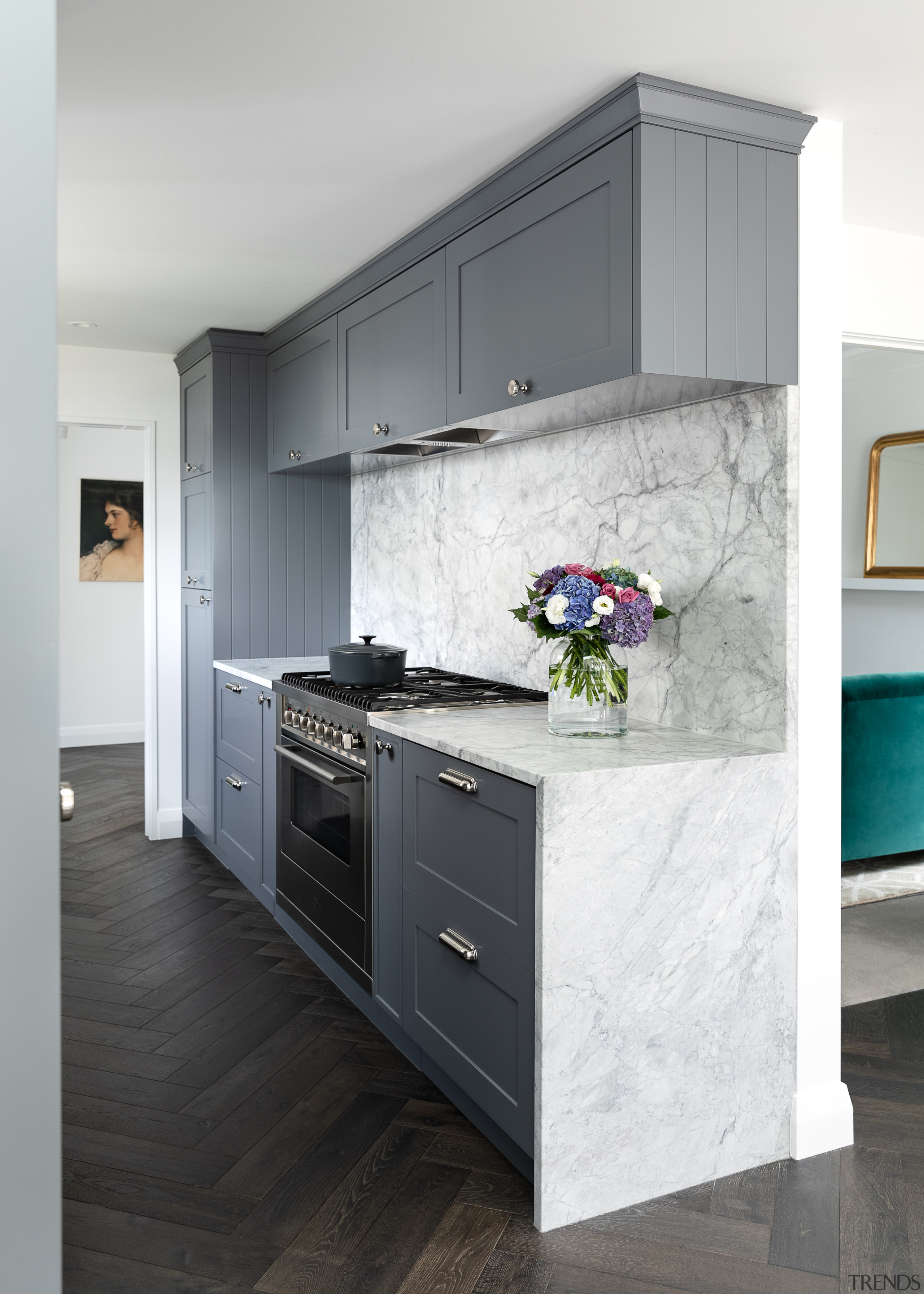 The grey cabinetry faces connect with the grey