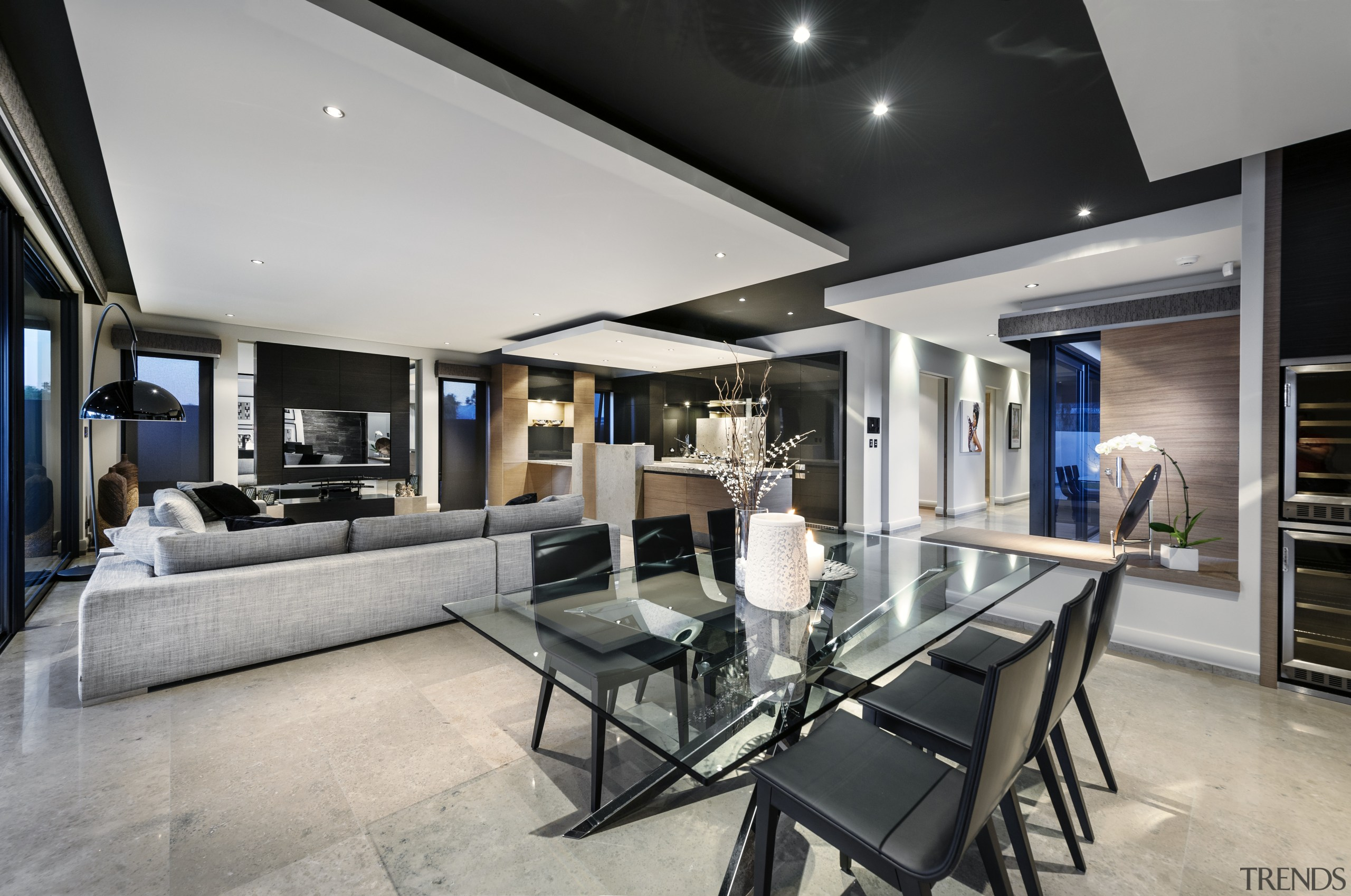 Kitchen connects with living and dining spaces with interior design, living room, real estate, gray, black