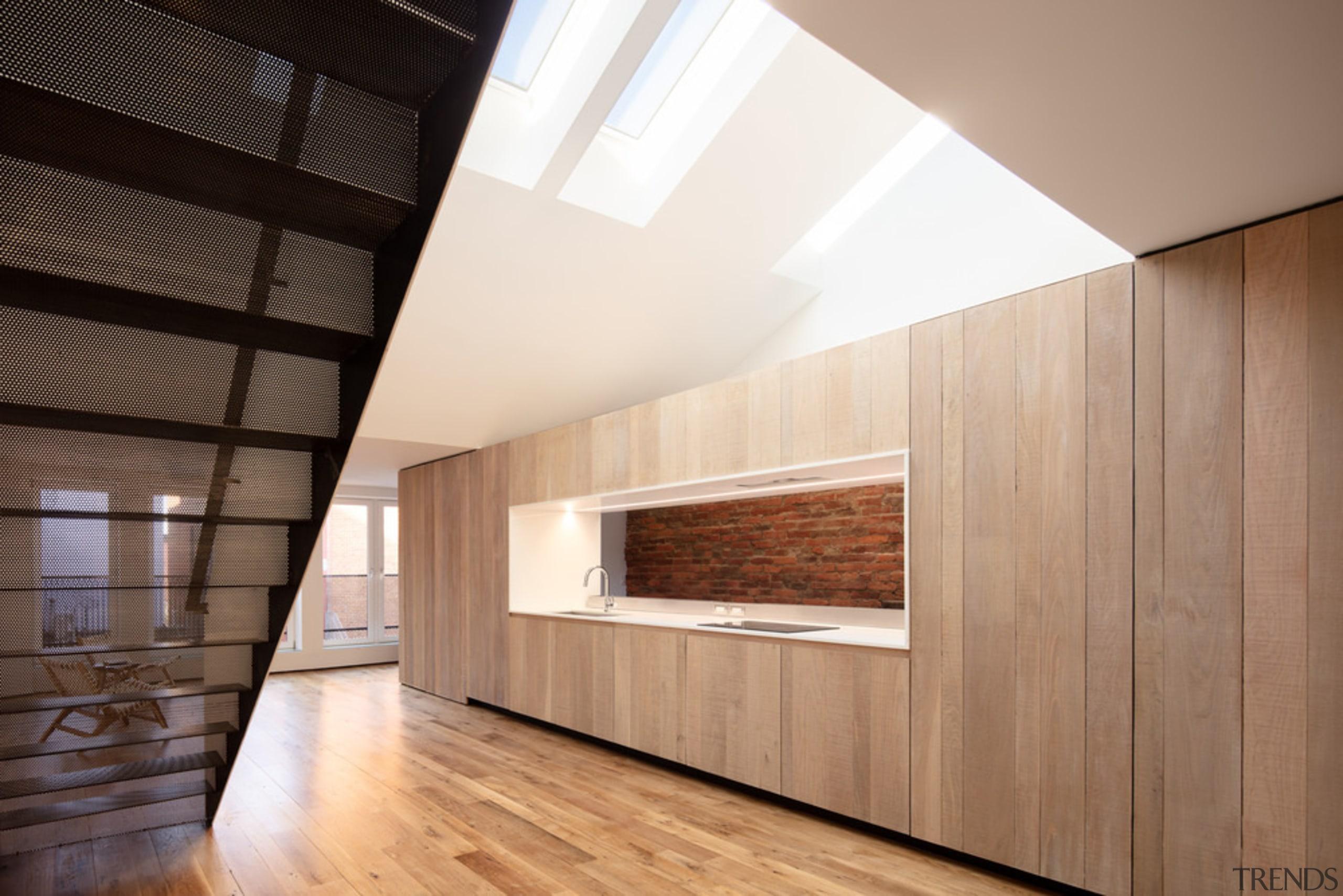 A window-like opening through the oak cabinet volume