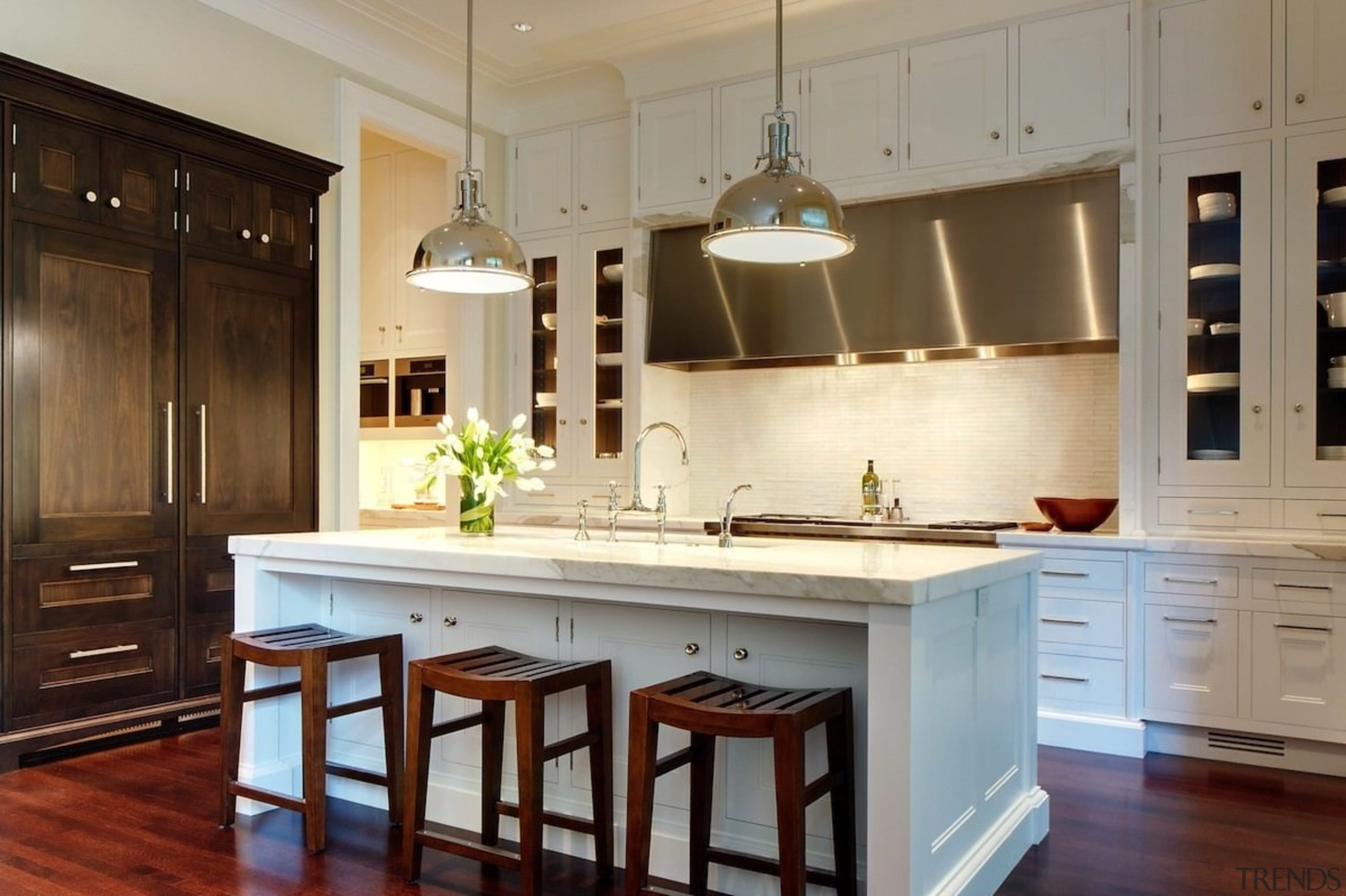 The kitchen is designed for entertaining - The cabinetry, countertop, cuisine classique, hardwood, interior design, kitchen, room, brown, gray