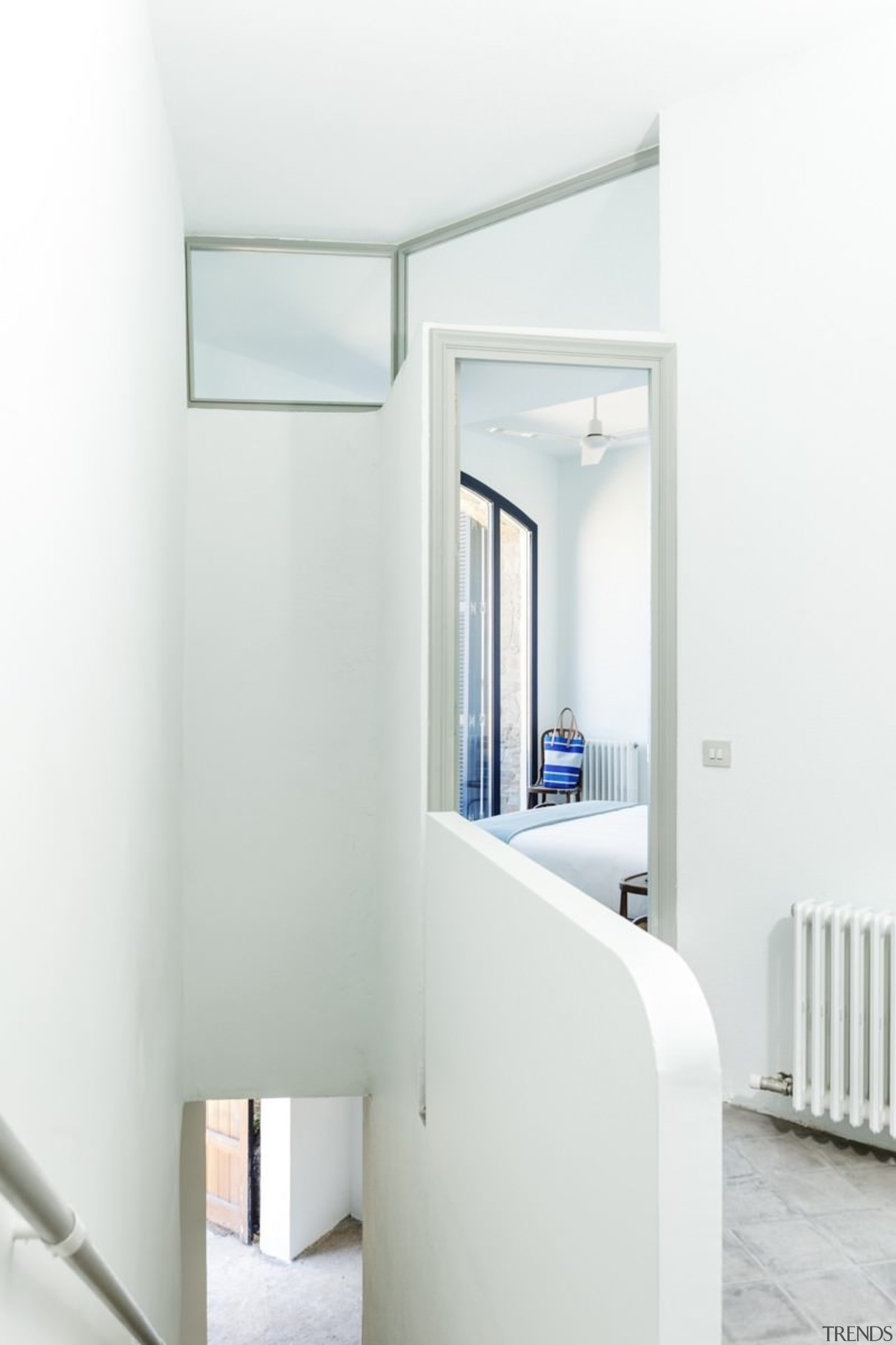 This curved wall stands out in this hallway architecture, house, interior design, product design, white