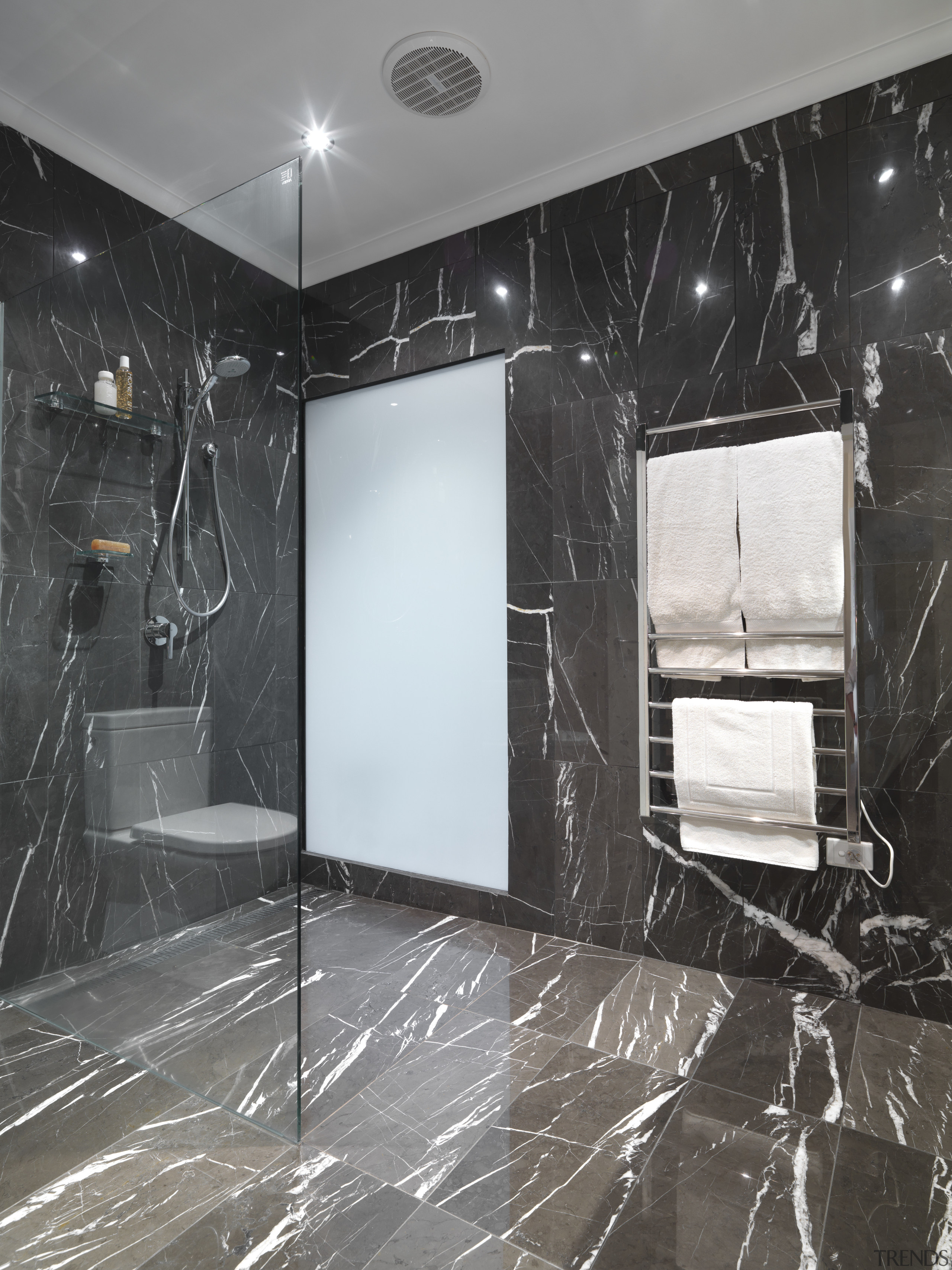 View of bathroom which features chocolate-coloured marble floor bathroom, ceiling, floor, flooring, glass, interior design, room, tile, wall, black, gray