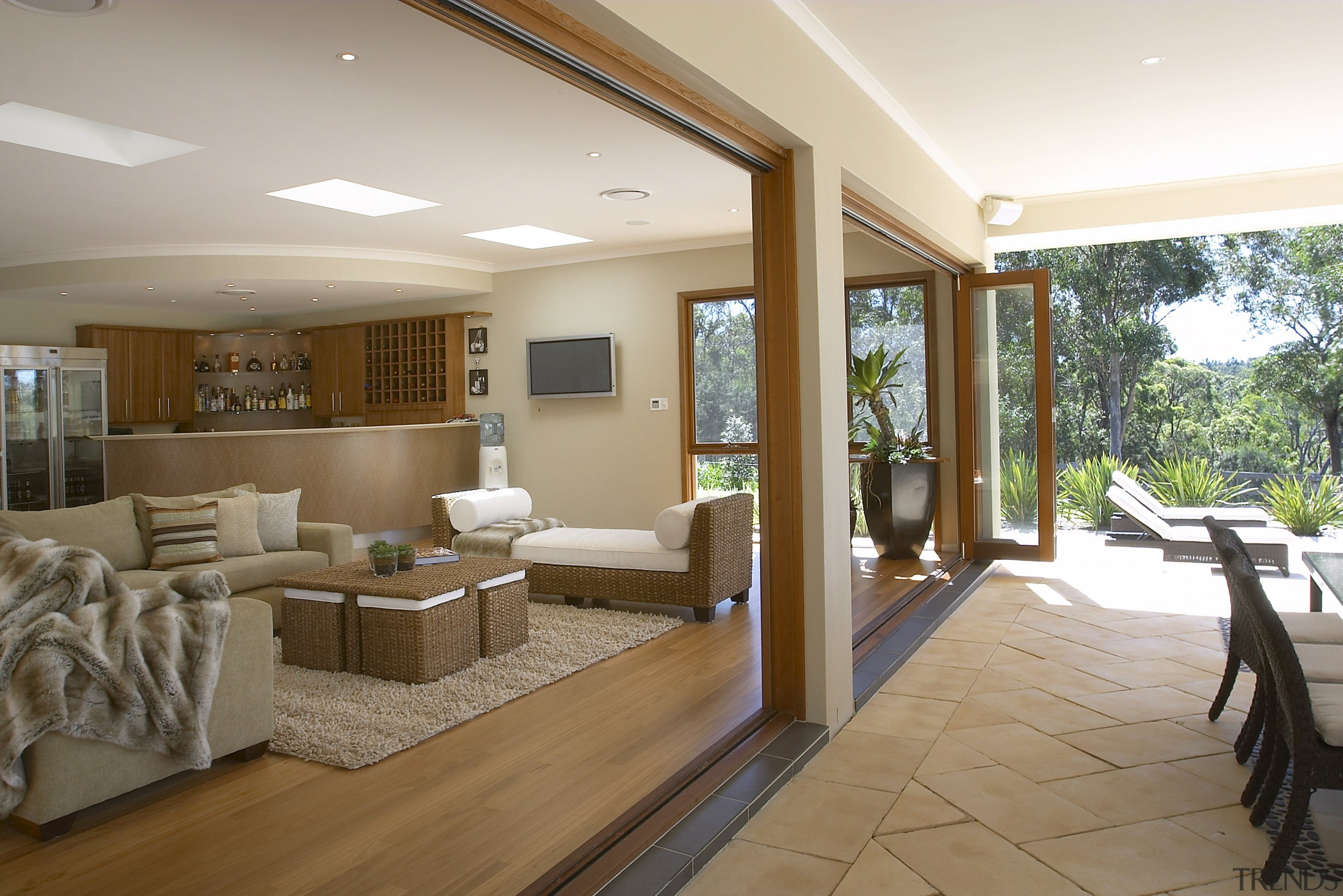 View of the outdoor area and a lounge ceiling, estate, floor, flooring, home, house, interior design, living room, property, real estate, room, window, brown, white