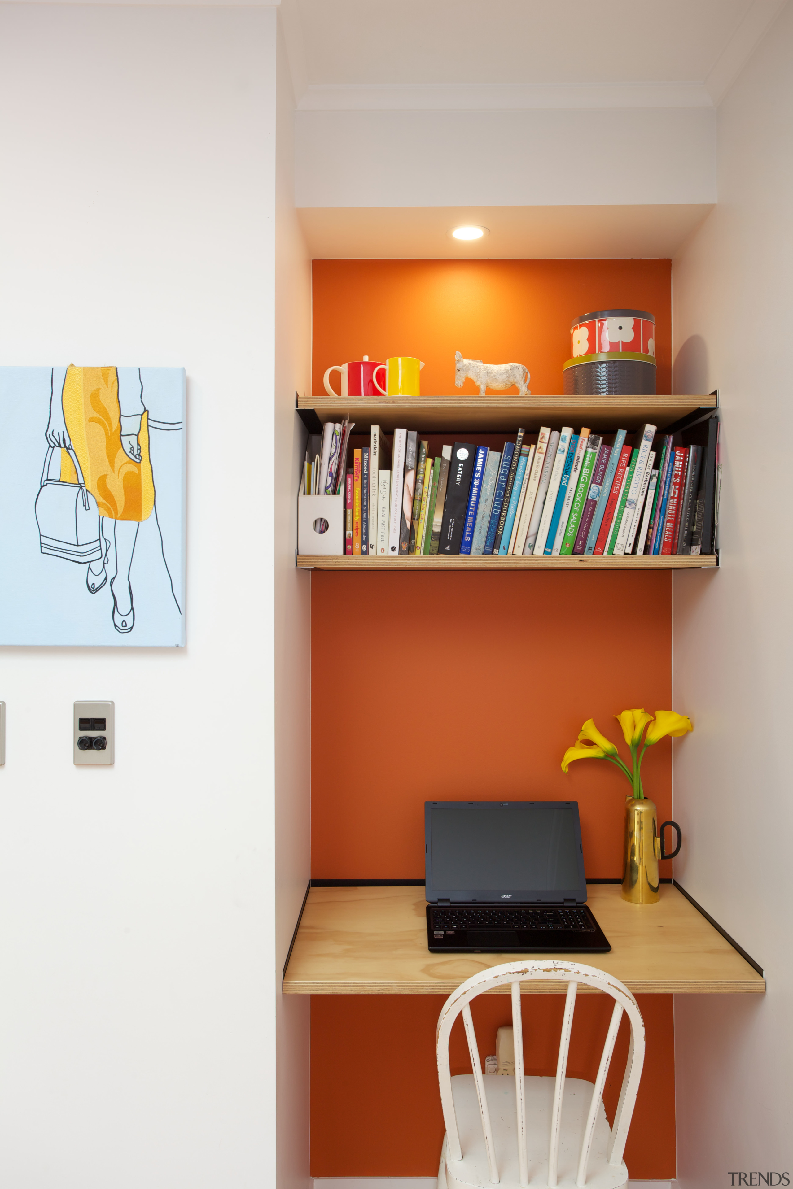 Interior designer Tomi Williams specified a black and bookcase, furniture, home, interior design, office, orange, room, shelf, shelving, table, yellow, gray