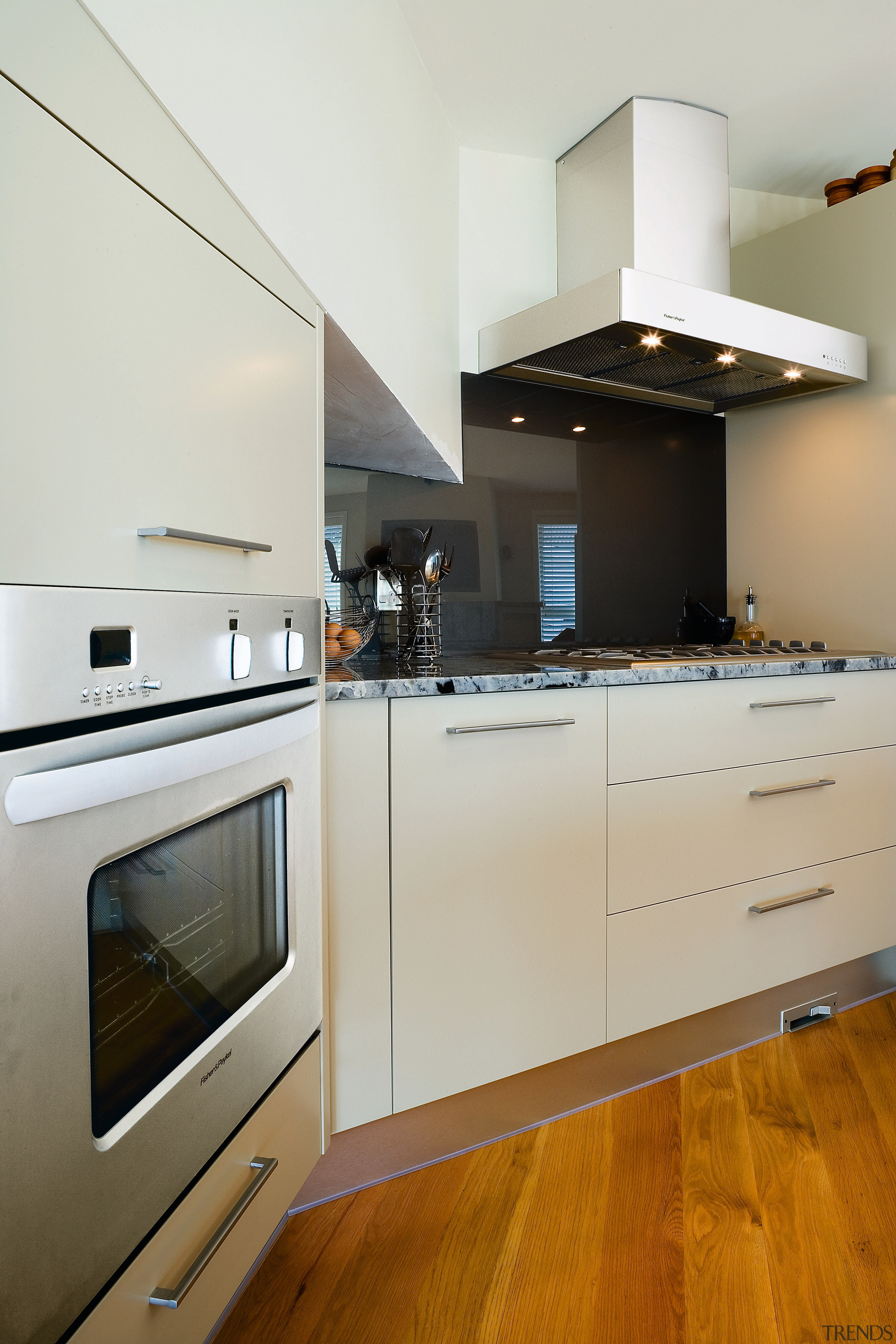 A view of this kitchen featuring the latest apartment, architecture, cabinetry, countertop, cuisine classique, floor, hardwood, home, home appliance, interior design, kitchen, kitchen appliance, kitchen stove, major appliance, room, wood, wood flooring, white