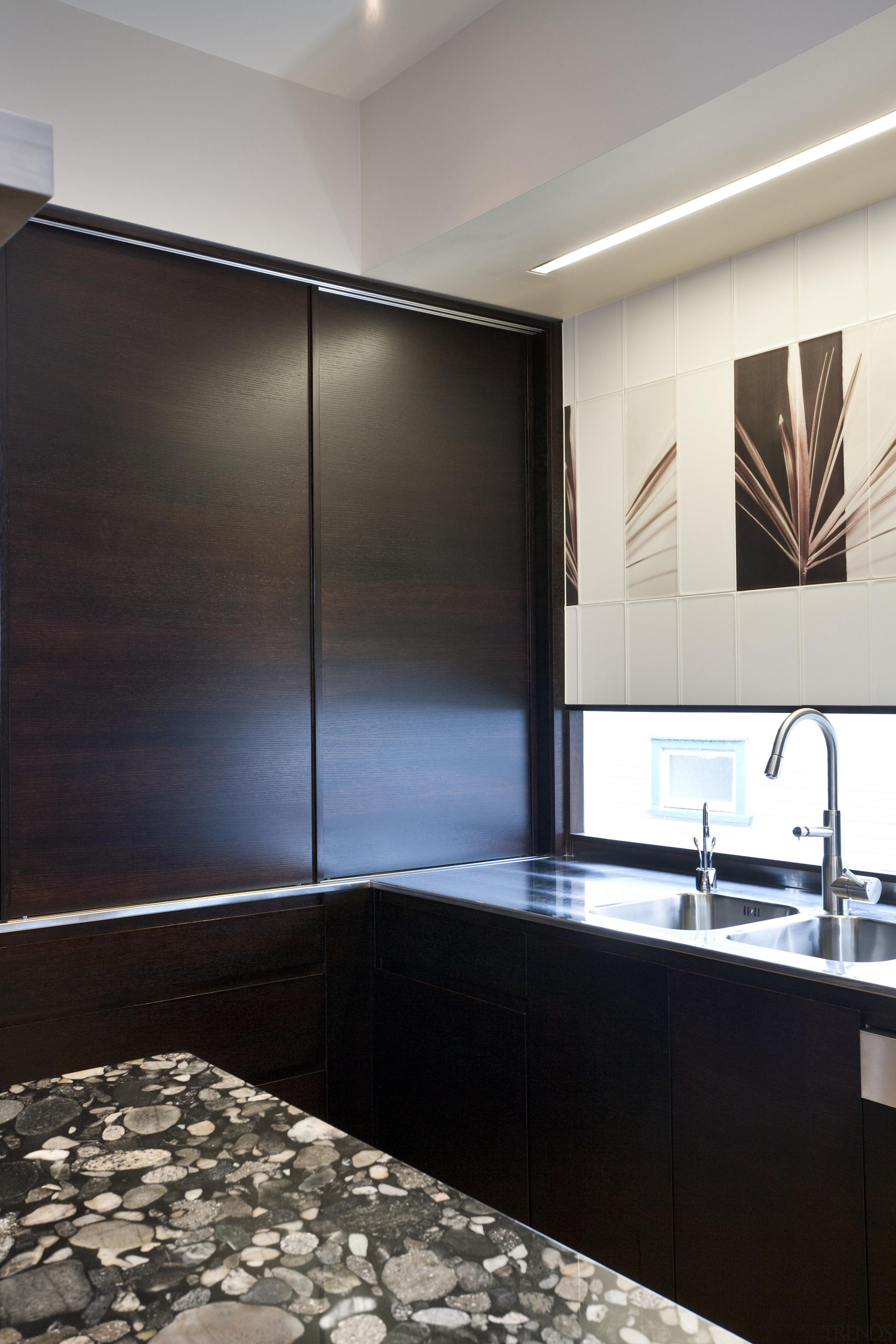So this area looks good even when the bathroom, ceiling, countertop, floor, flooring, glass, interior design, room, sink, black, gray
