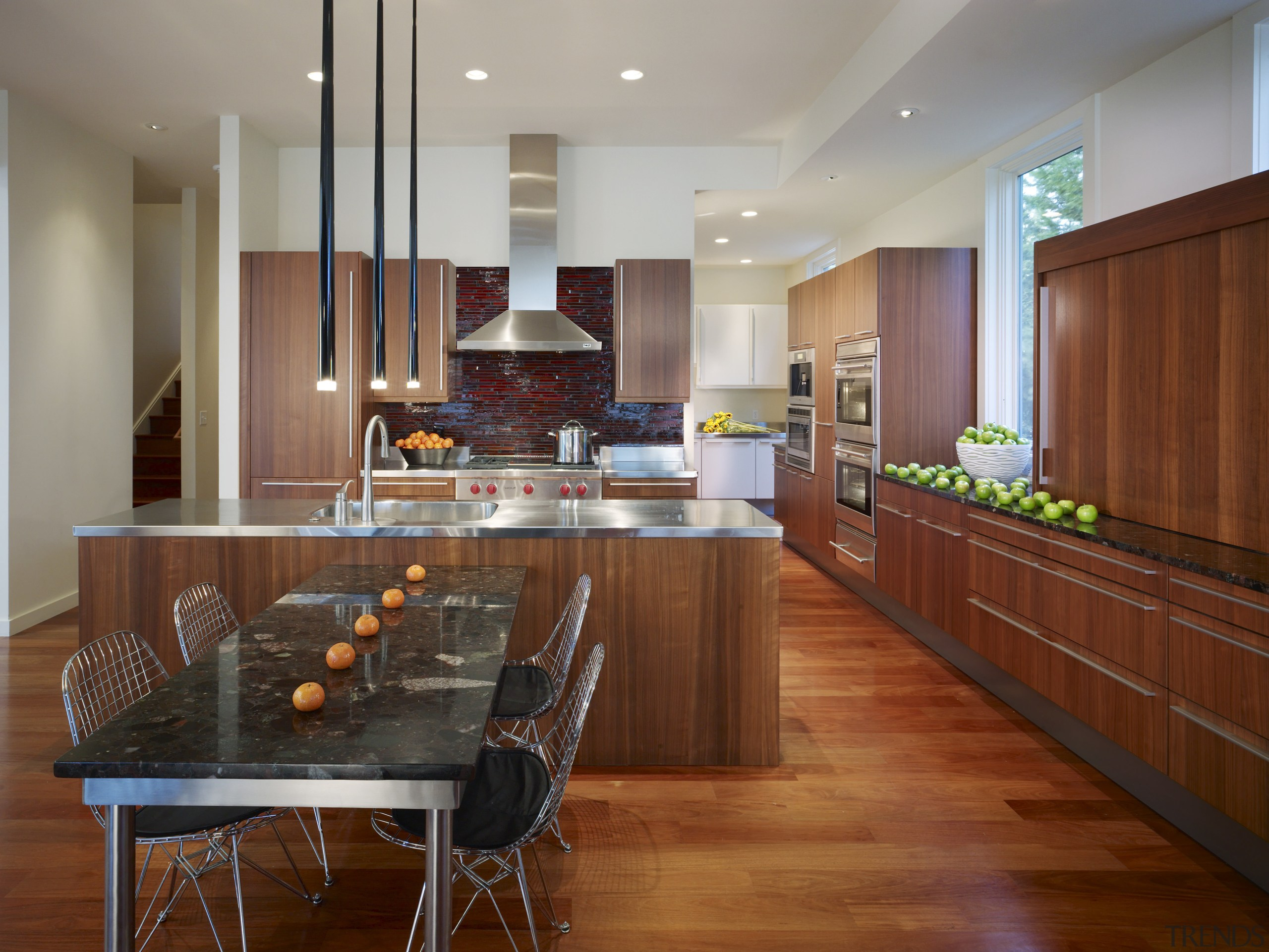 View of a kitchen which combines commerical touches cabinetry, countertop, dining room, flooring, hardwood, interior design, kitchen, real estate, room, wood flooring, brown, gray