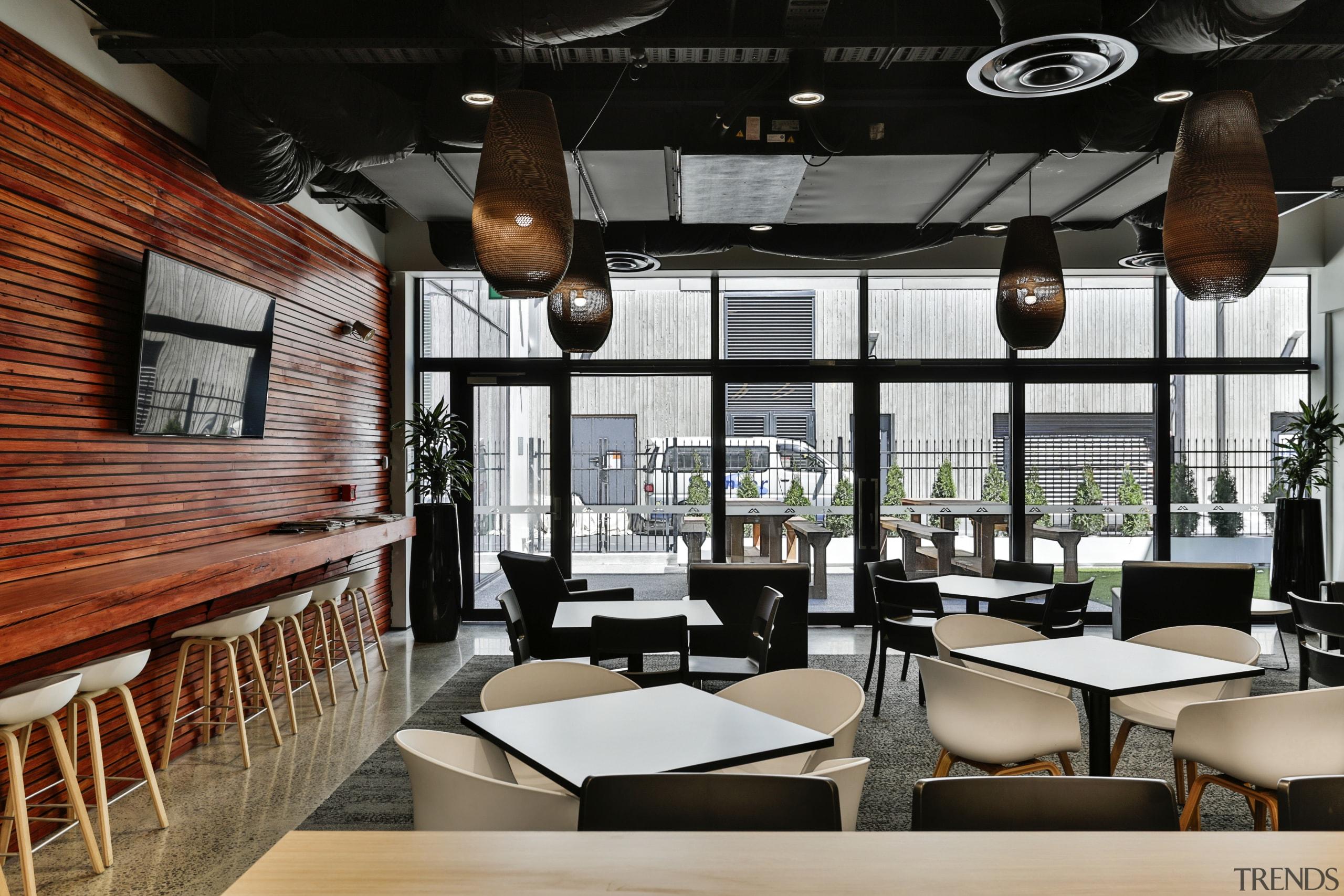 The cafeteria at the Kathmandu headquarters features recycled café, furniture, interior design, restaurant, black
