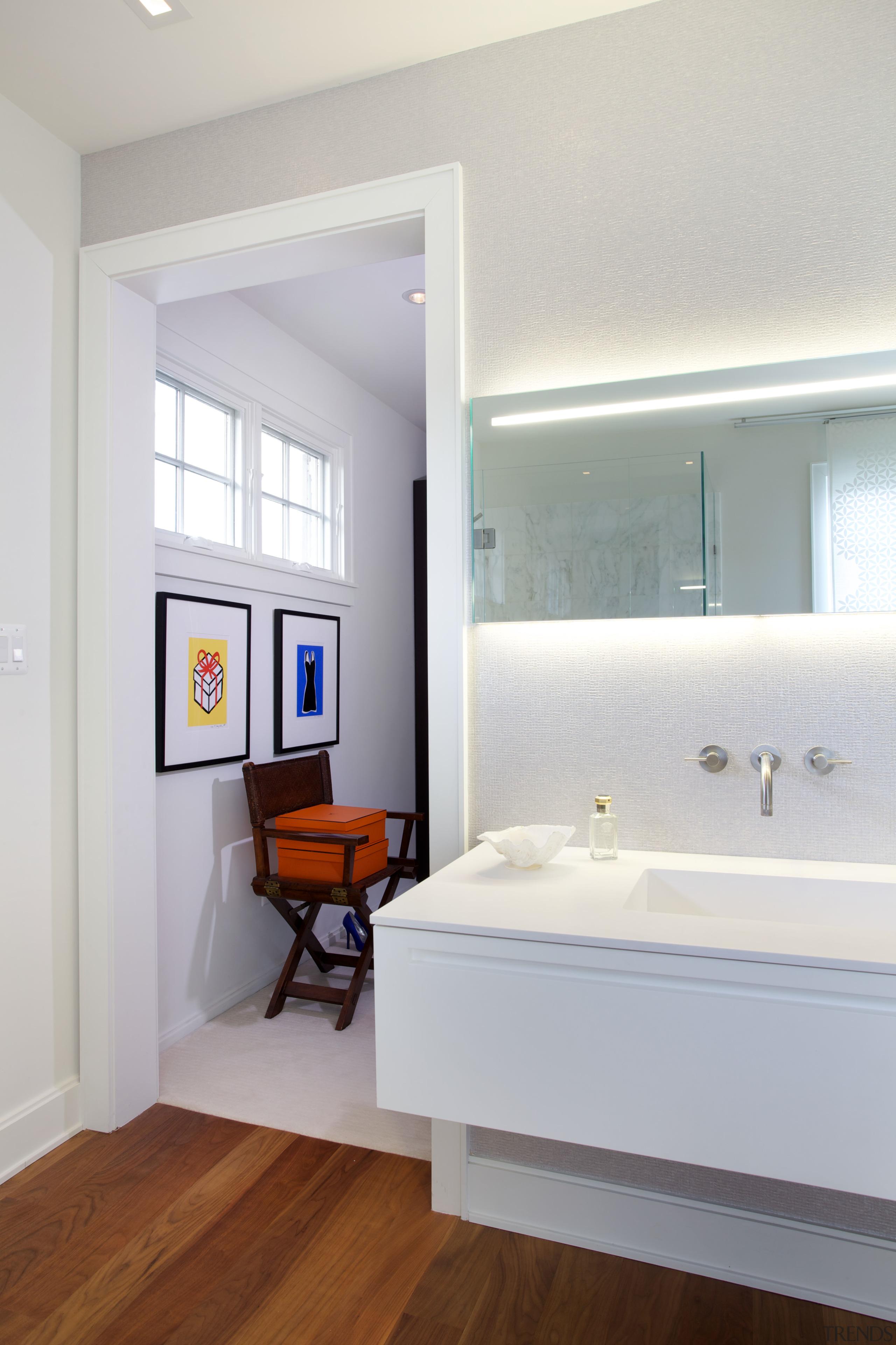 This master bathroom, designed by Nestor Santa-Cruz, continues architecture, bathroom, ceiling, daylighting, floor, flooring, home, house, interior design, room, sink, wall, window, wood flooring, white, gray
