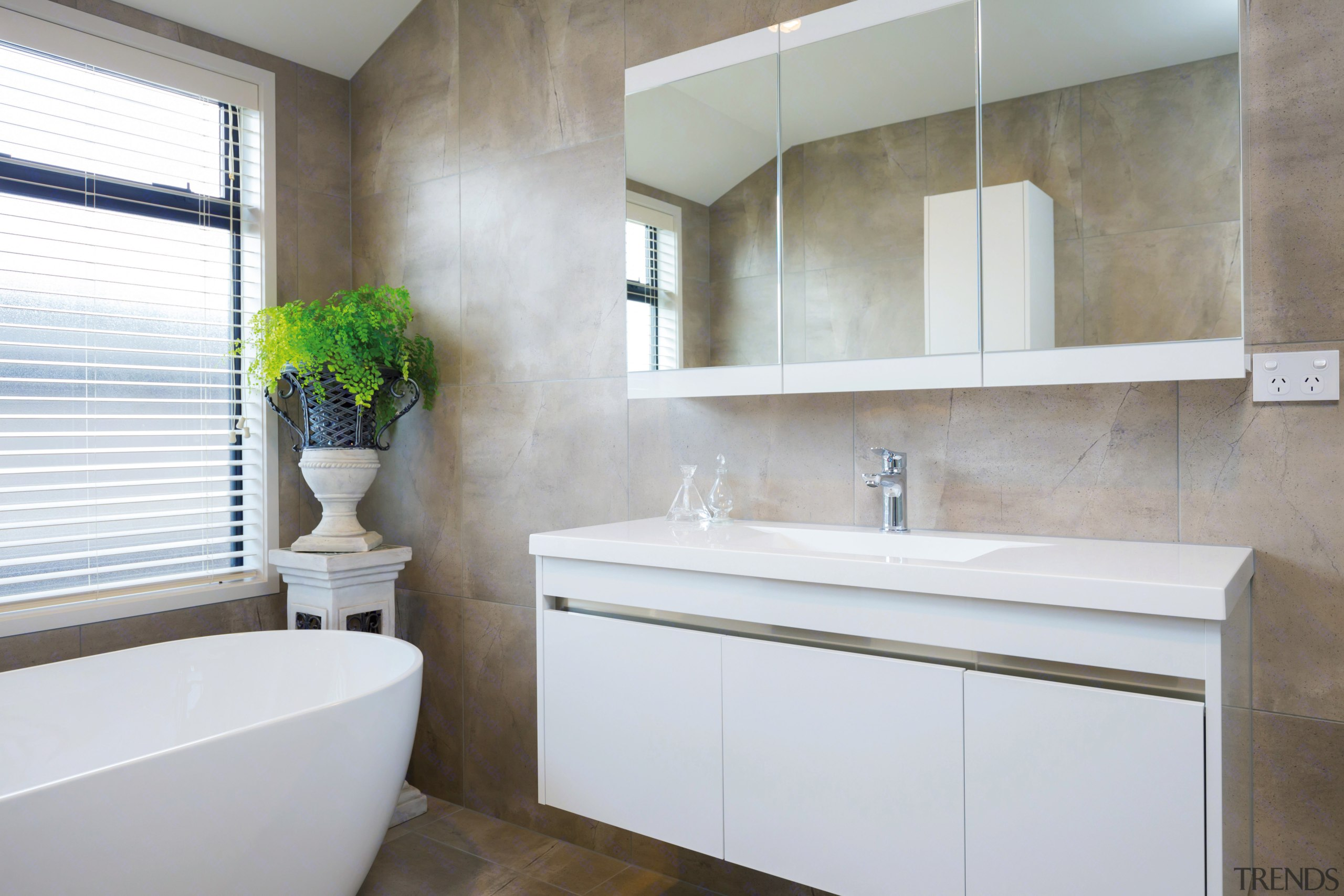 Trends] | The main bathroom in this GJ Gardner showhome has a ...