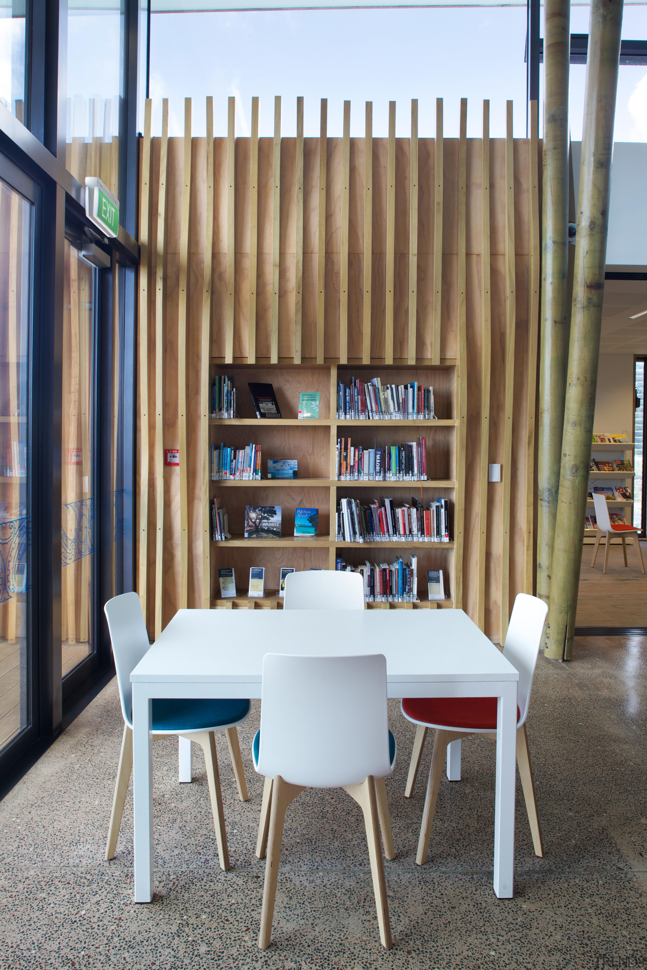 The Waiheke library provides a variety of seating chair, furniture, interior design, shelving, table, gray