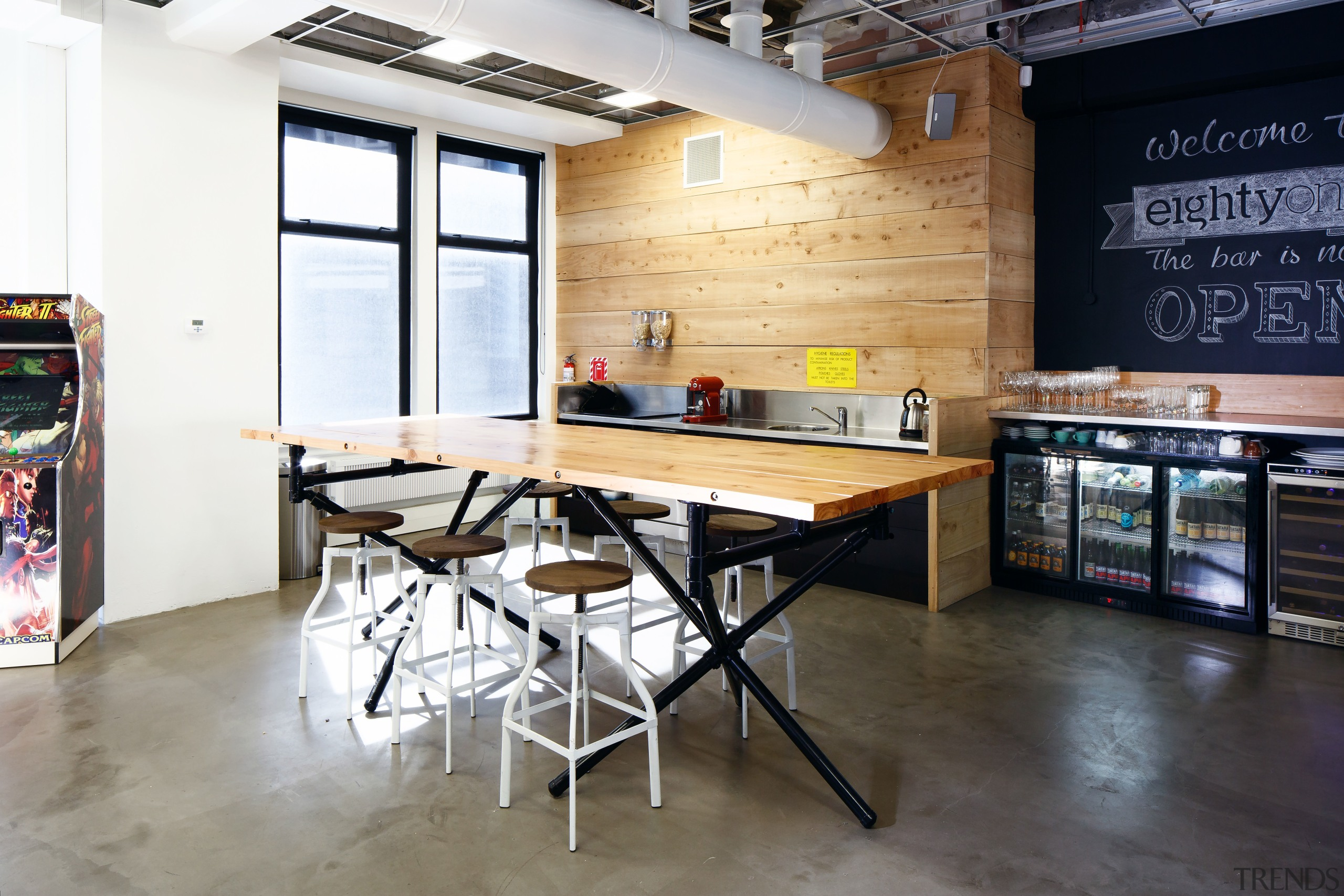 The wood and stainless steel kitchen and adjacent countertop, flooring, furniture, interior design, kitchen, loft, table, white, black