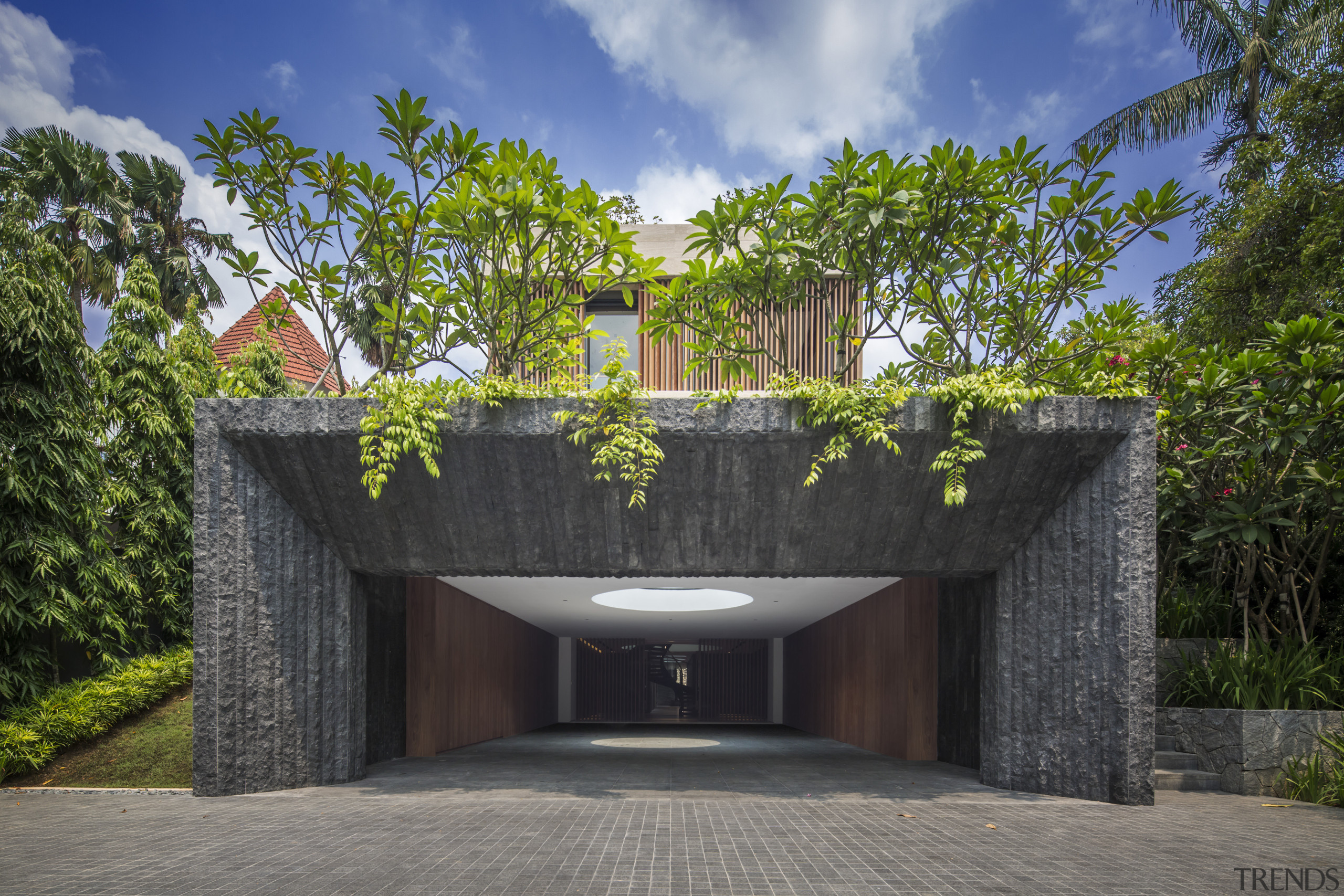 Guests arriving at this new home drive into architecture, building, estate, facade, home, house, property, real estate, residential area, tree, black