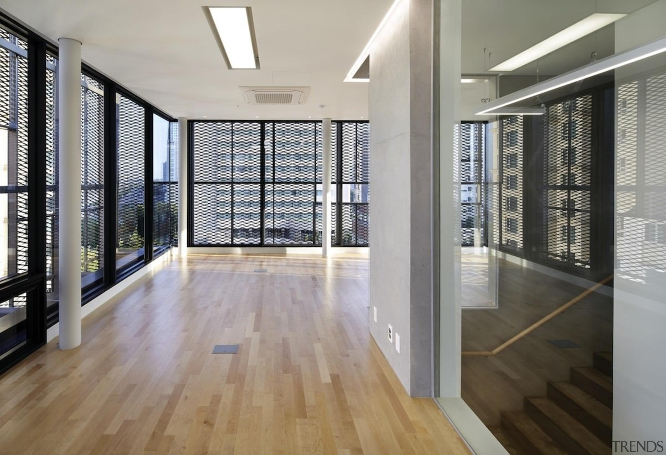 The 925 Building - The 925 Building - architecture, daylighting, estate, floor, flooring, handrail, hardwood, interior design, laminate flooring, real estate, wall, window, wood, wood flooring, gray
