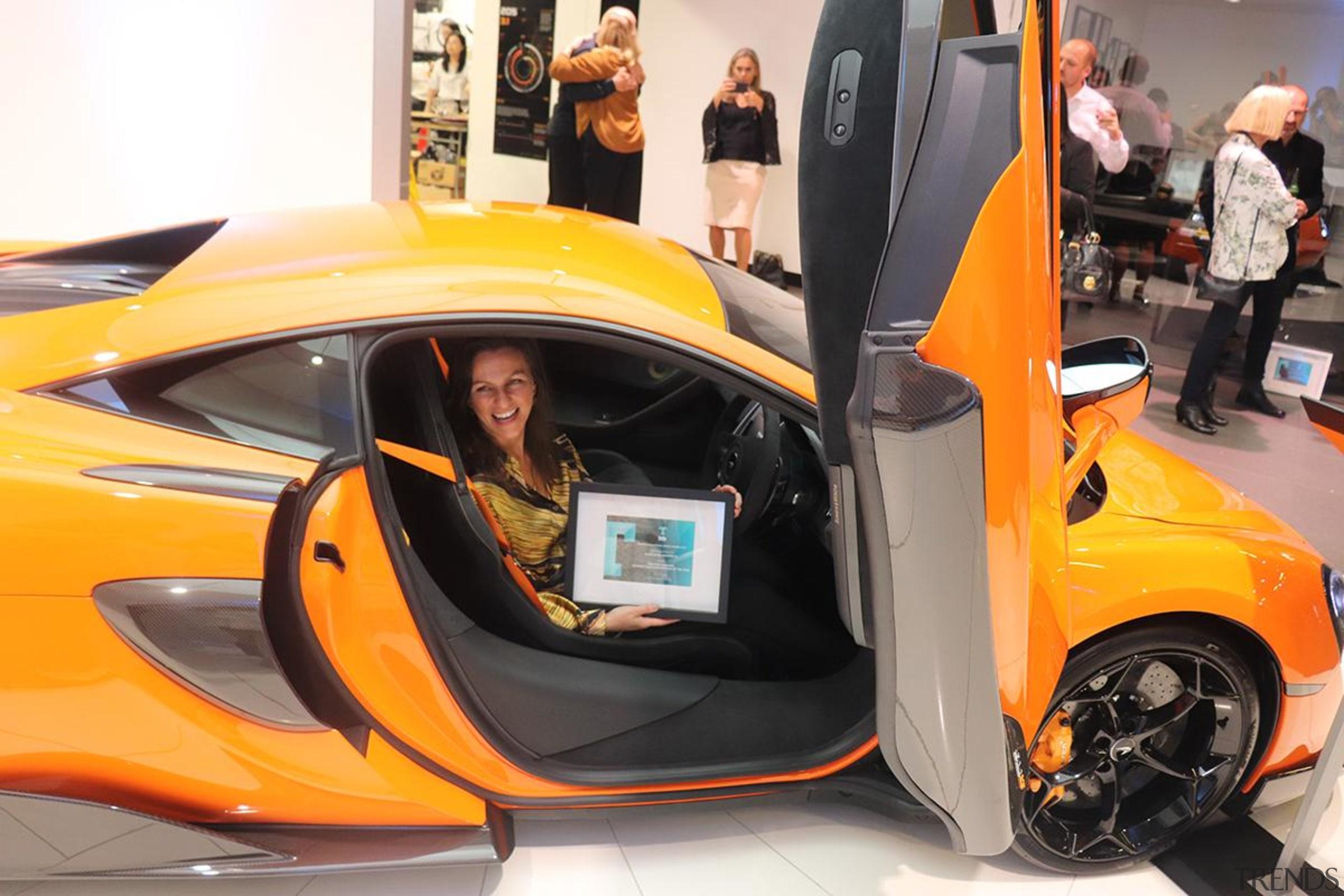 Eliska Lewis - auto show | automotive design auto show, automotive design, car, concept car, land vehicle, mclaren automotive, mclaren mp4-12c, mclaren p1, sports car, supercar, vehicle, vehicle door, orange, black