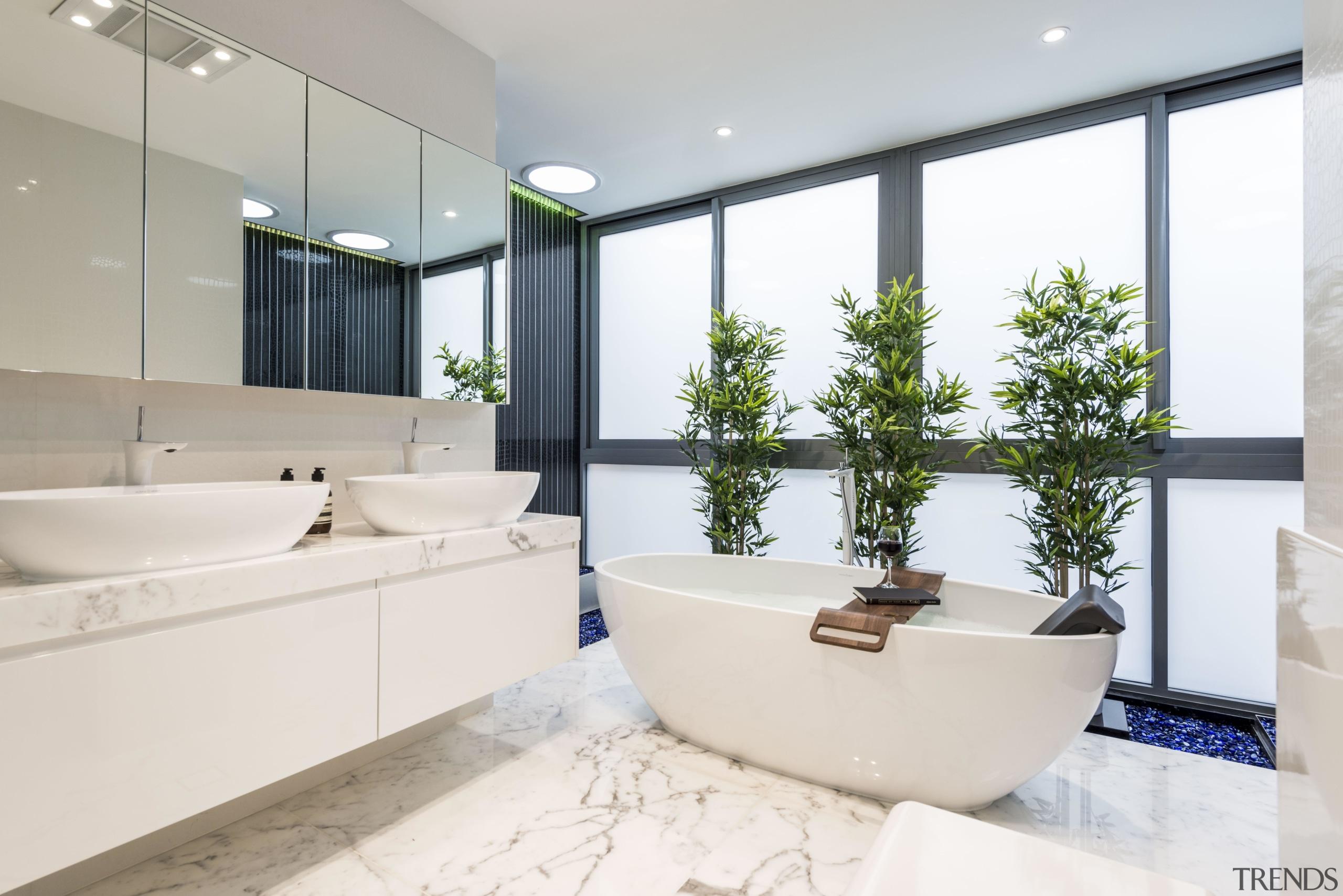 The black Caesarstone in a crocodile pattern that bathroom, estate, home, interior design, property, real estate, room, white