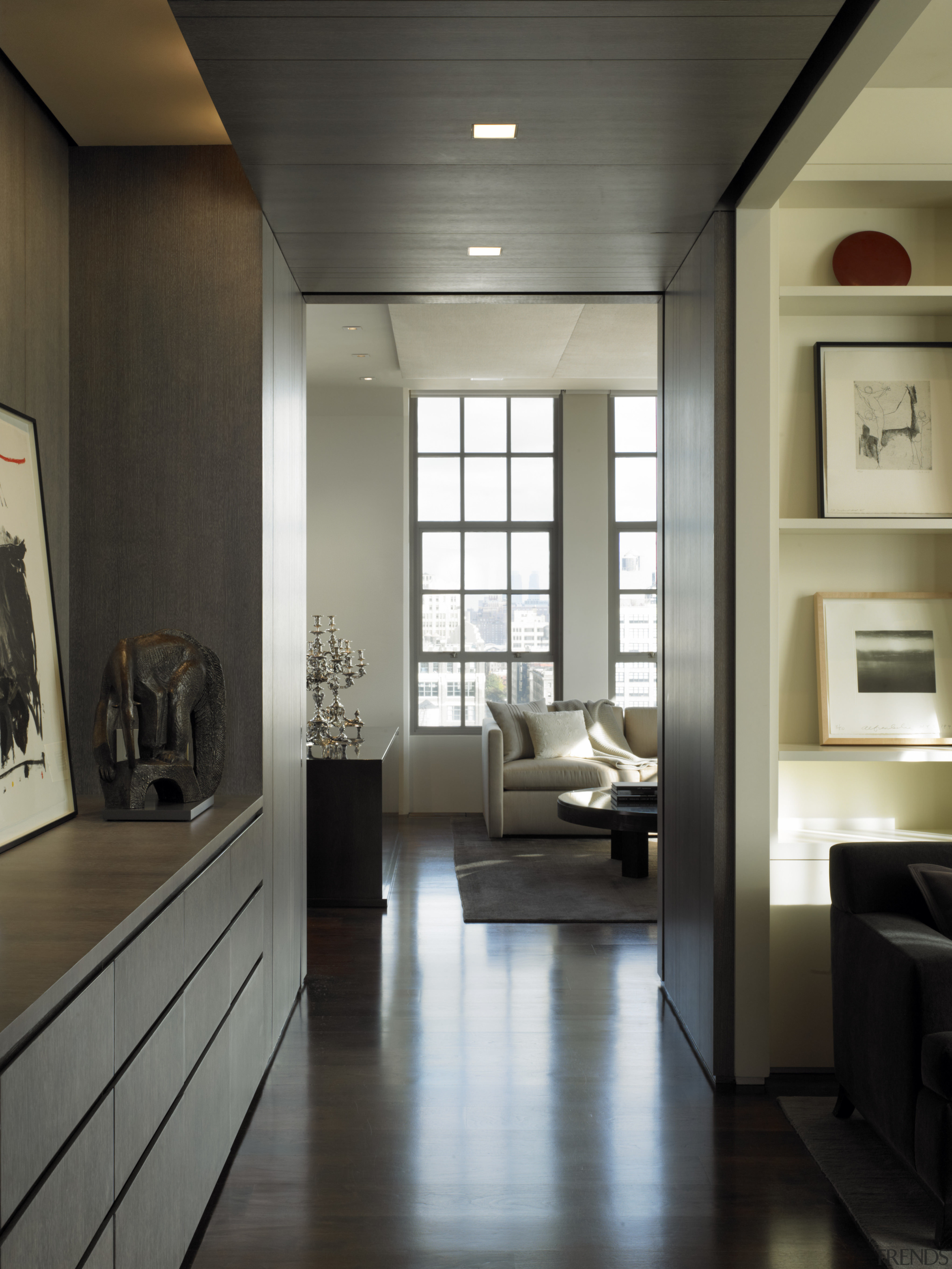 View of this contemporary apartment that has been ceiling, floor, flooring, furniture, interior design, living room, room, wood flooring, black, gray