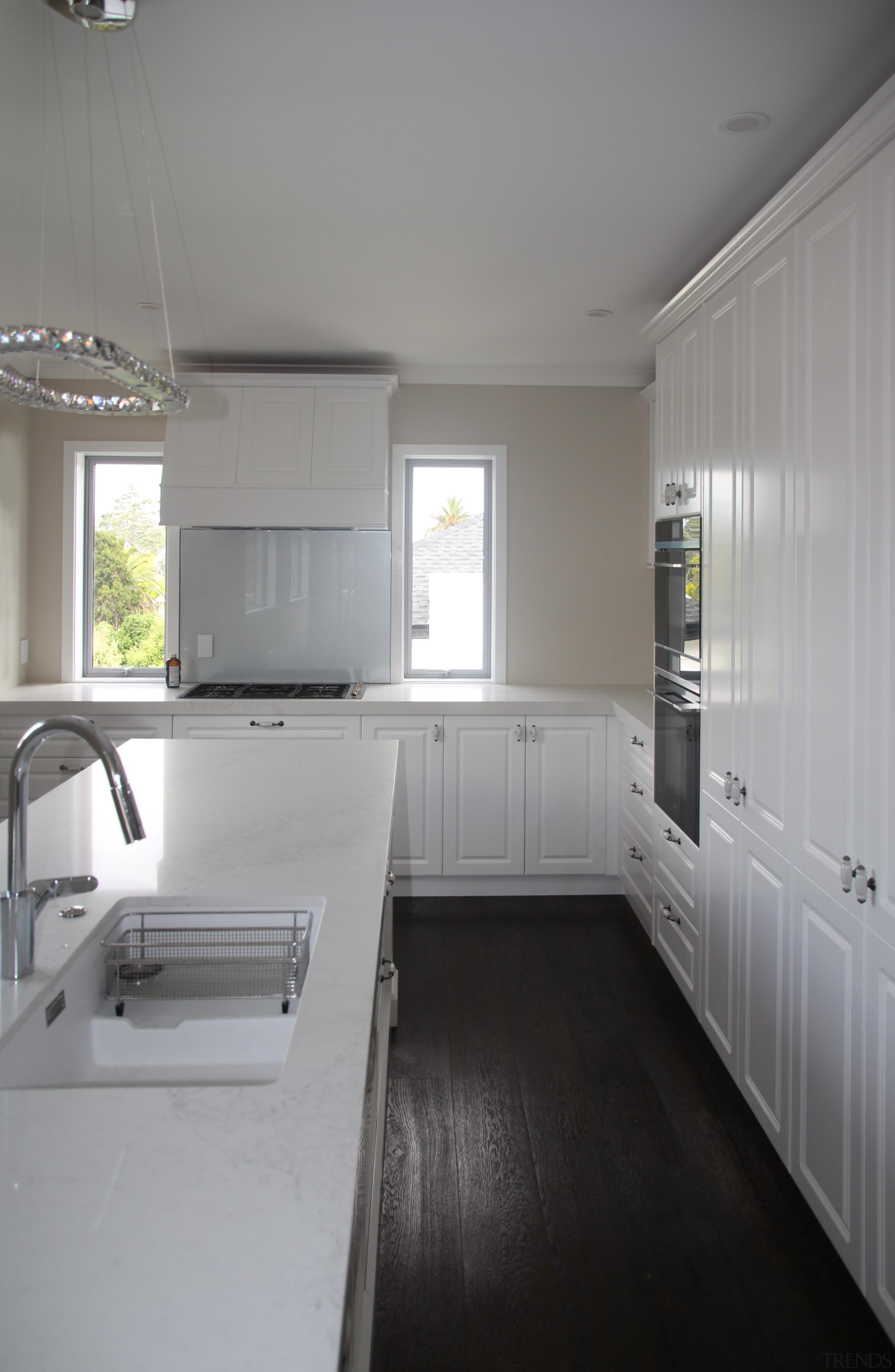 An Italian engineered dark oak floor, in the countertop, daylighting, floor, home, house, interior design, kitchen, real estate, room, gray