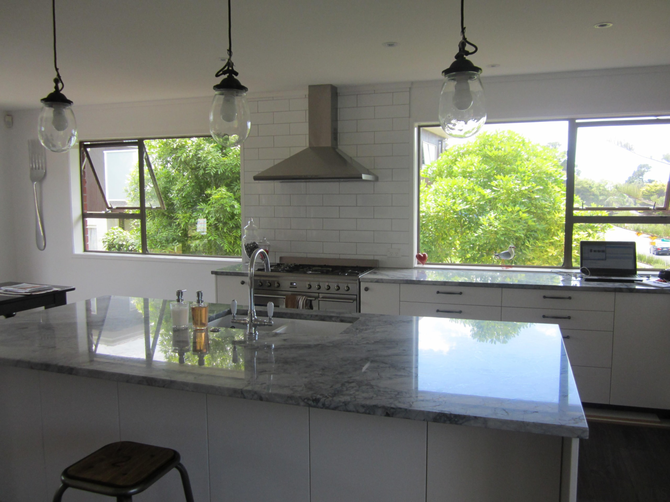 This kitchen renovation features a freestanding oven and countertop, glass, home, interior design, kitchen, real estate, room, window, gray, black