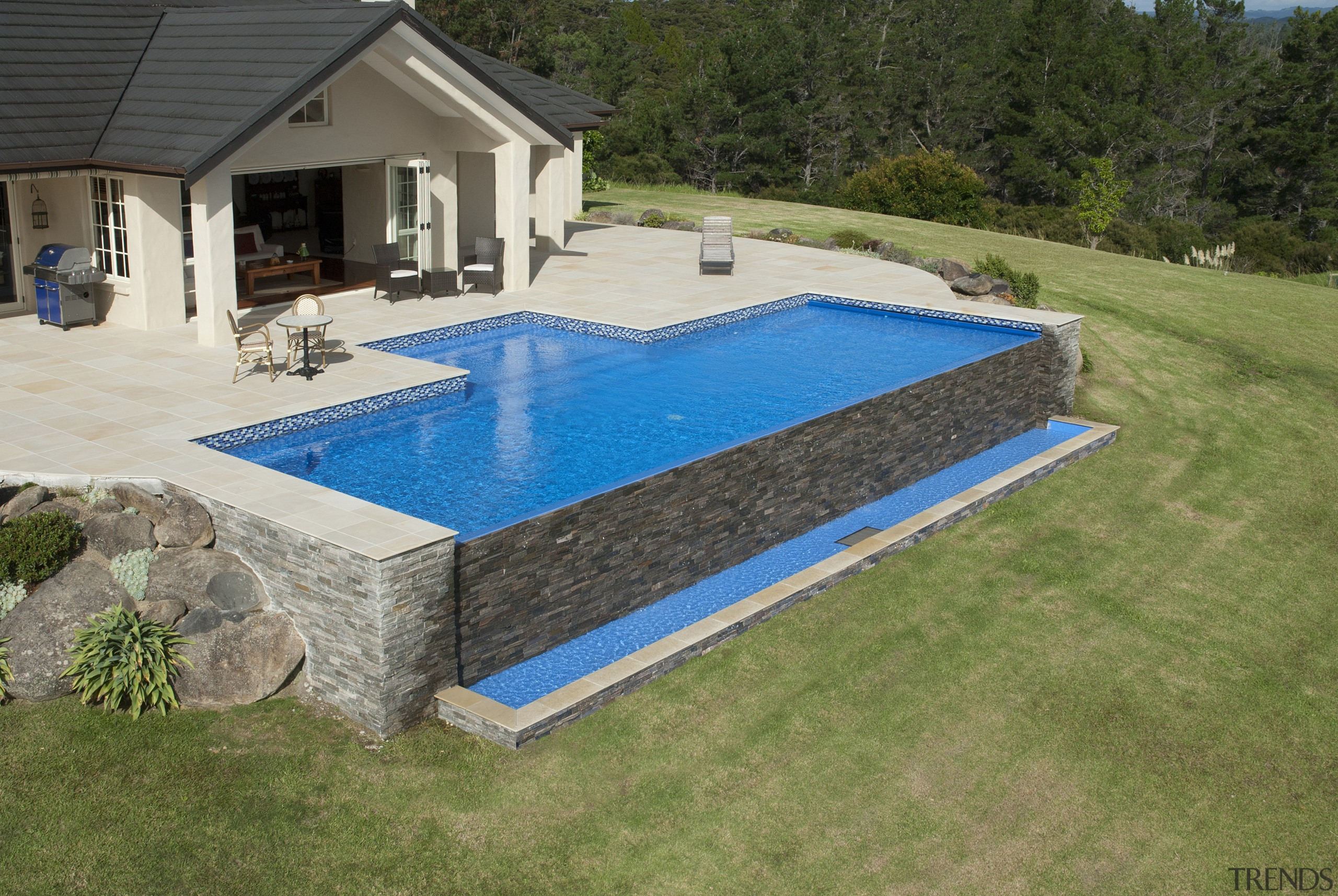 This is a view of the pool designed backyard, grass, leisure, property, real estate, swimming pool, yard, brown