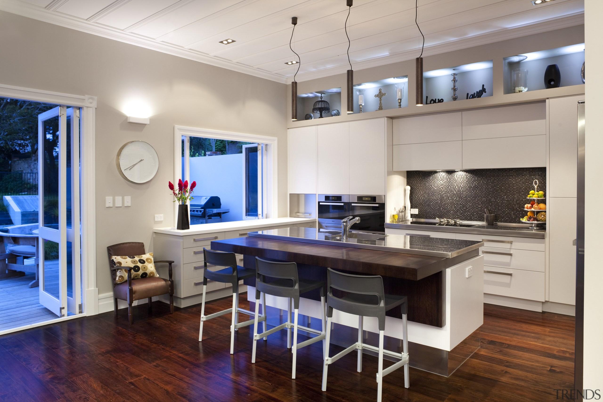 island in centre, hanging lights above, door to countertop, floor, flooring, hardwood, interior design, kitchen, real estate, room, wood flooring, gray