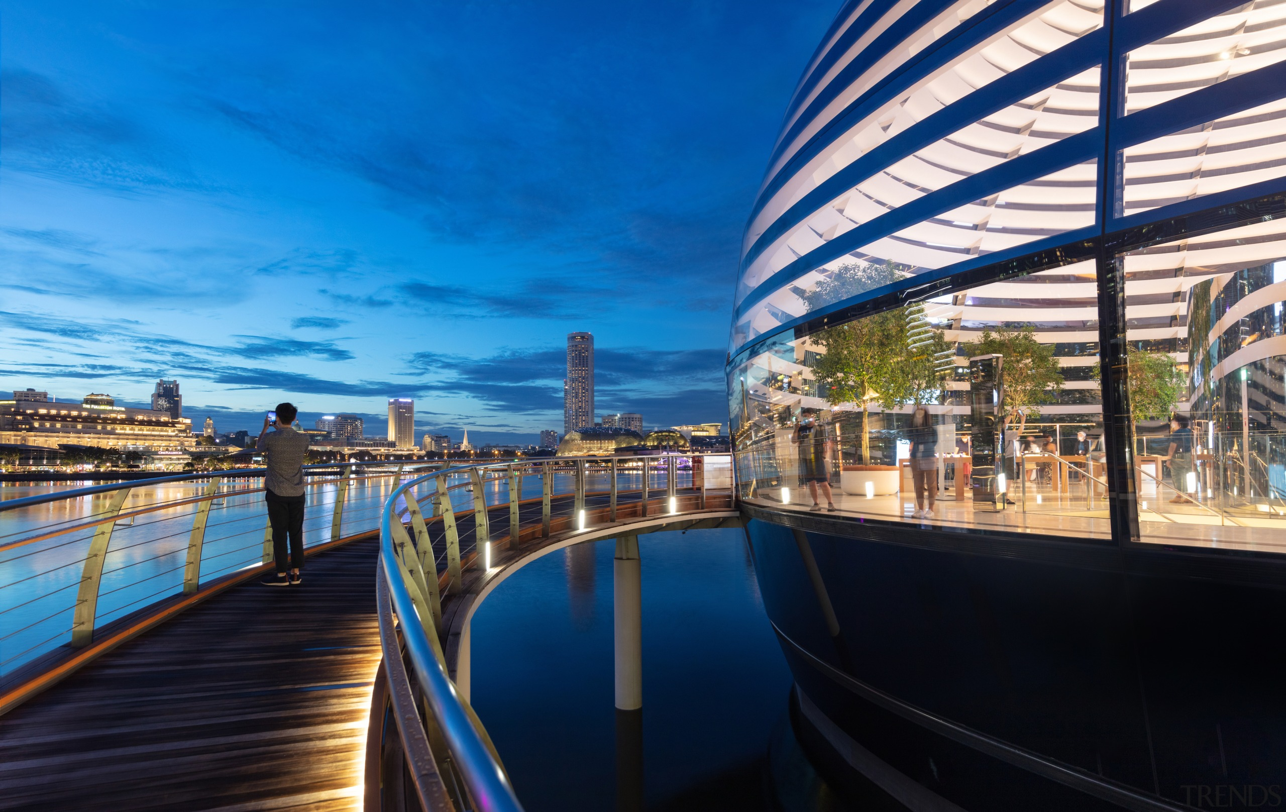 A lit walkway runs round the futuristic retail