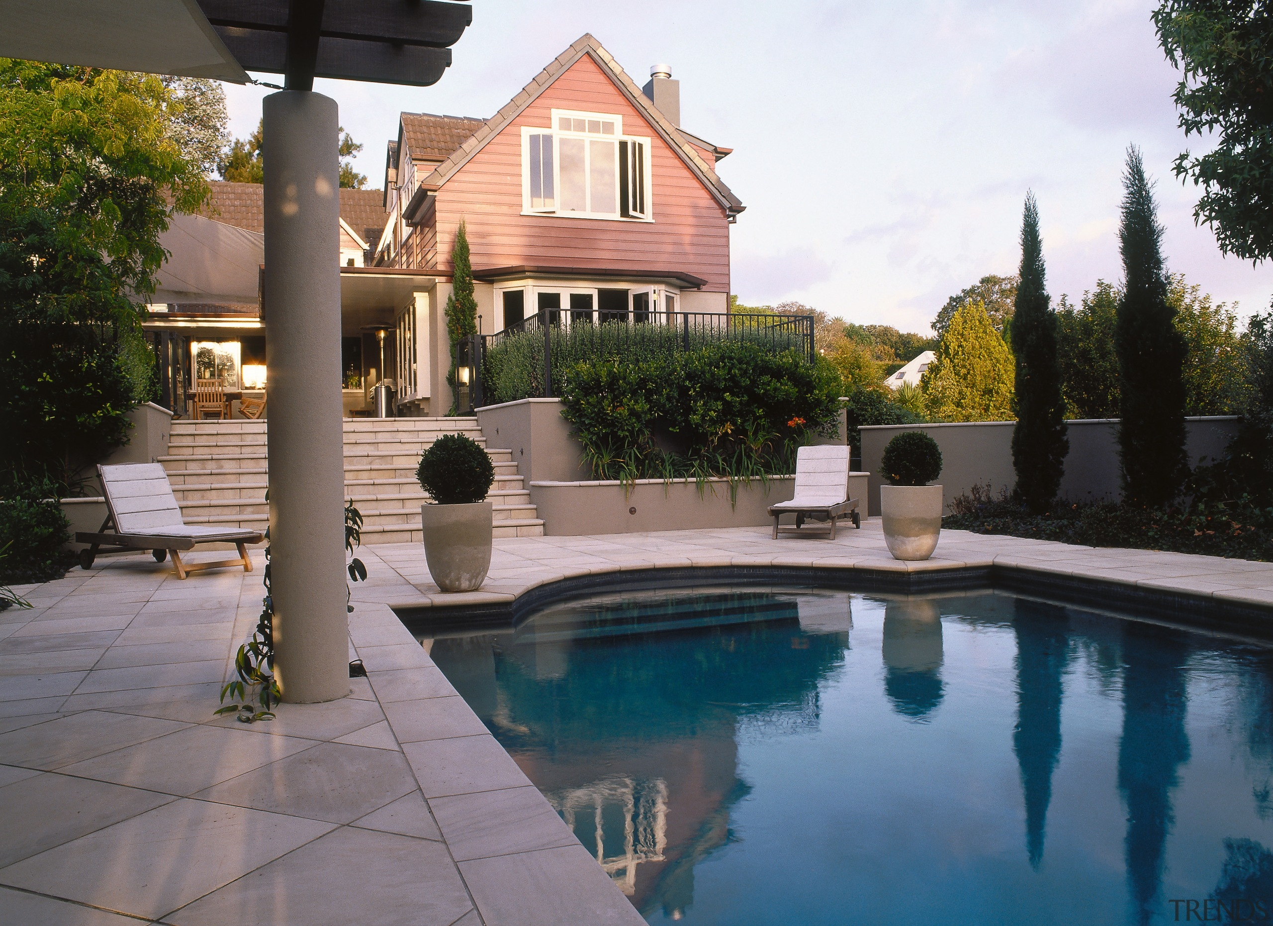A view of some paving from Original Stone. backyard, estate, home, house, outdoor structure, patio, property, real estate, residential area, swimming pool, villa, yard, gray