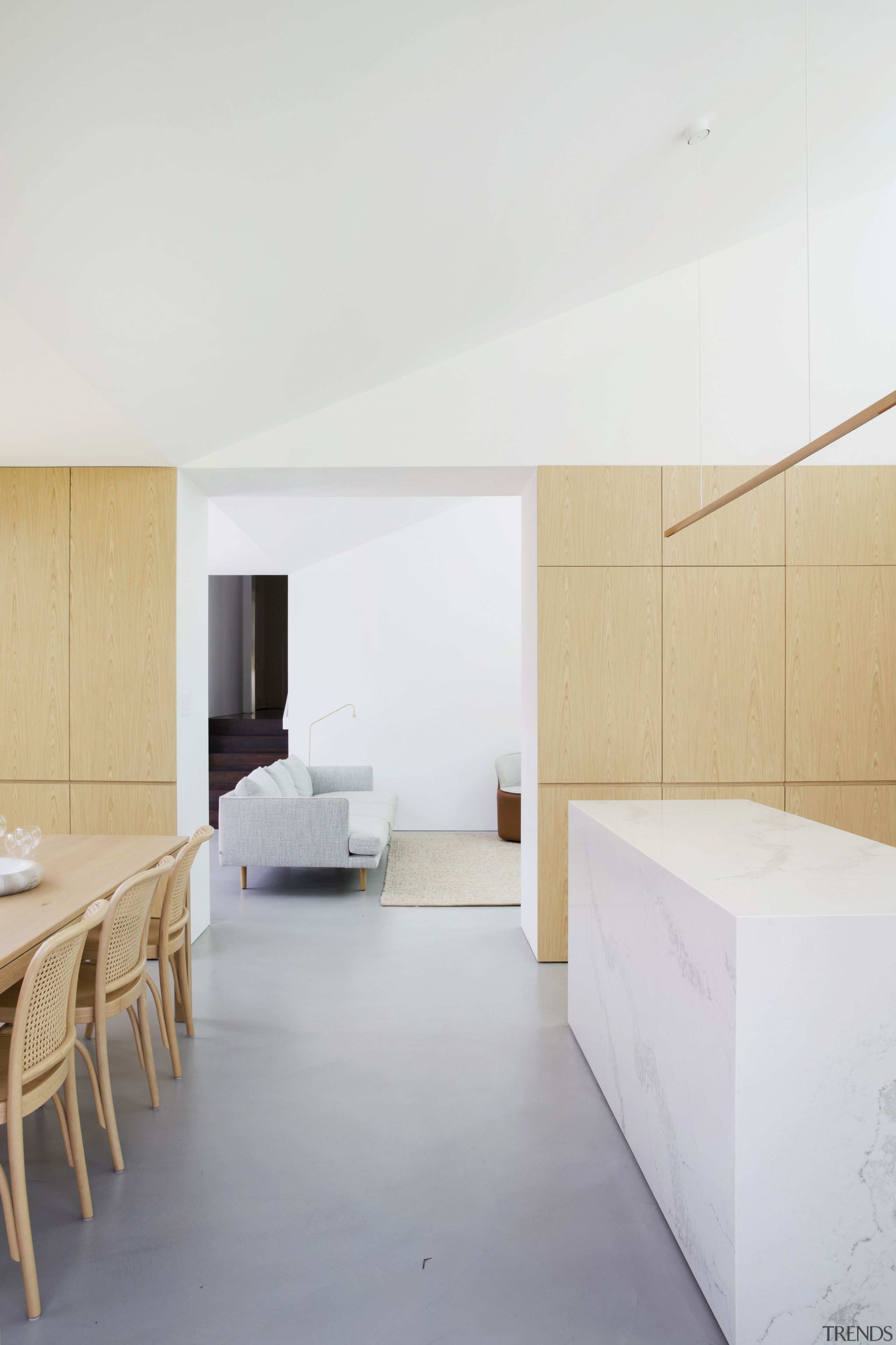 A contemporary linear brass pendant over the kitchen home, architecture, , floor, house, interior design, table, wall, wood, white, kitchen, Studio Prineas