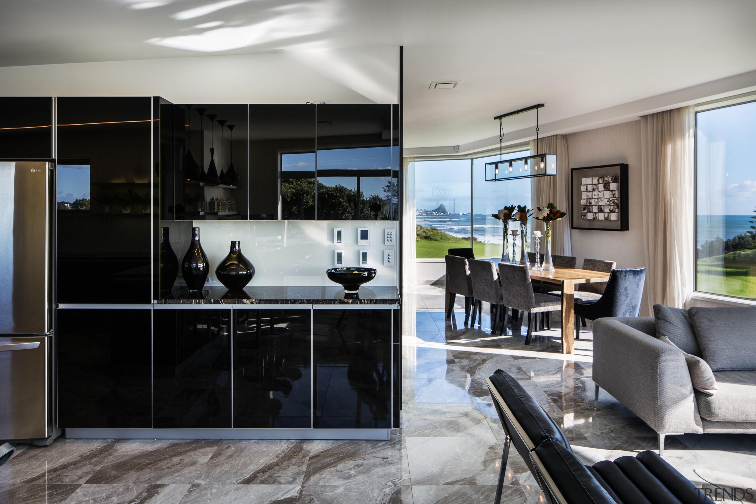 High gloss, textural Italian porcelain floor tiles emulate interior design, kitchen, window, gray, black