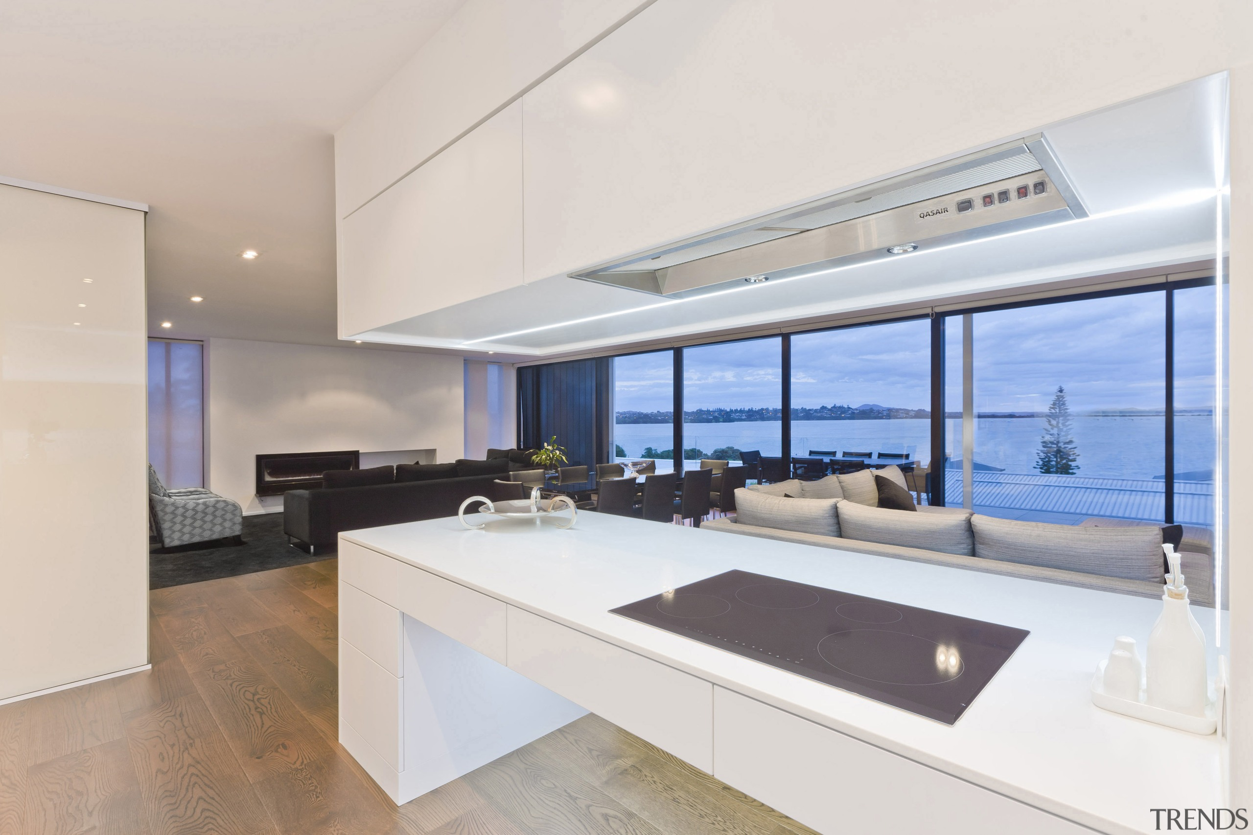 A close up view of the cooktop through architecture, house, interior design, kitchen, penthouse apartment, property, real estate, window, white
