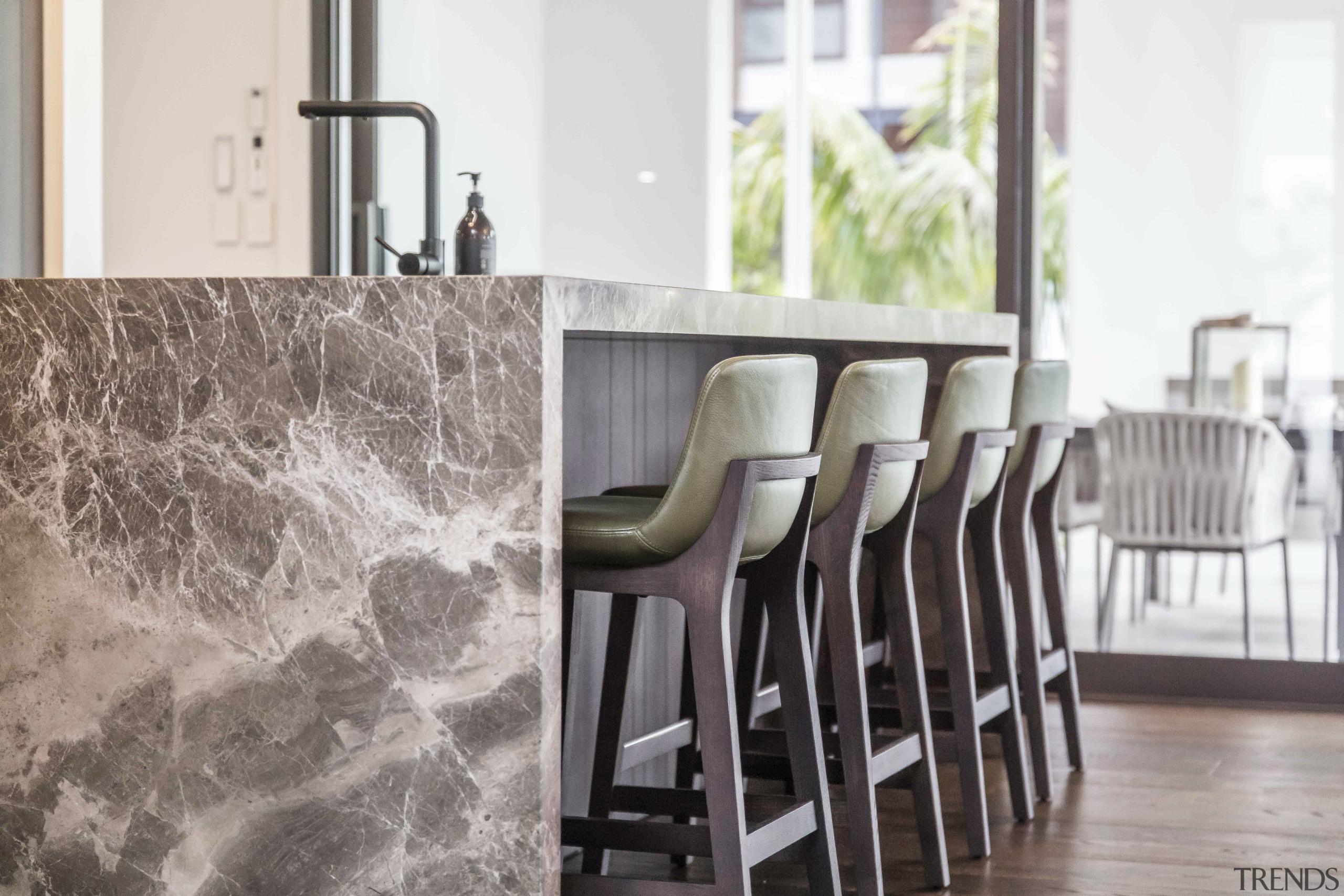Marble and rich wood veneer create impact in floor, flooring, stools, home, interior design, Kitchen, marble, benchtop, tap, Studio Italia