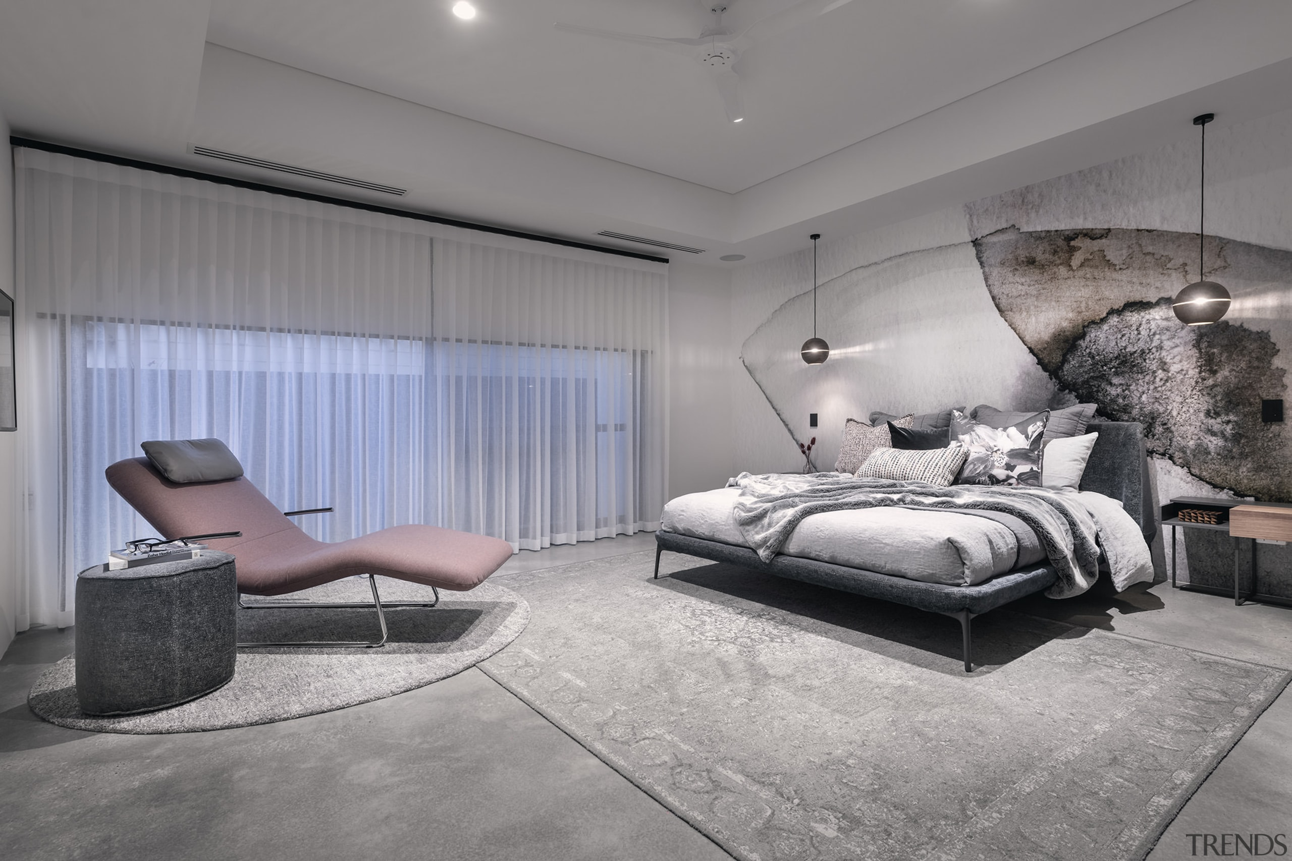 The bedroom's contemporary feature wall finish tones with
