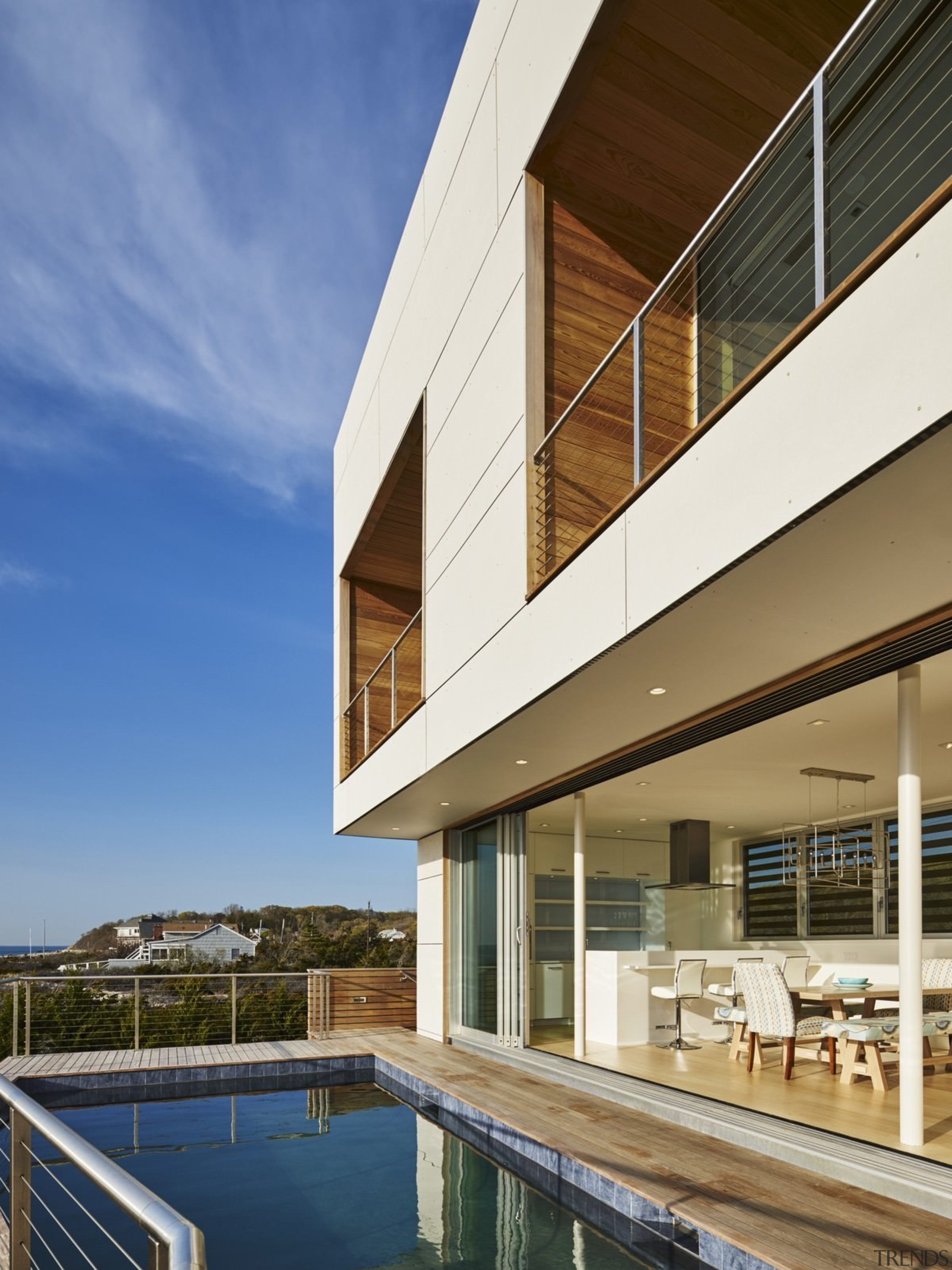 Wood panels and wood soffits line the upper apartment, architecture, building, condominium, corporate headquarters, daylighting, estate, facade, home, house, property, real estate, reflection, residential area, sky, window, brown, blue