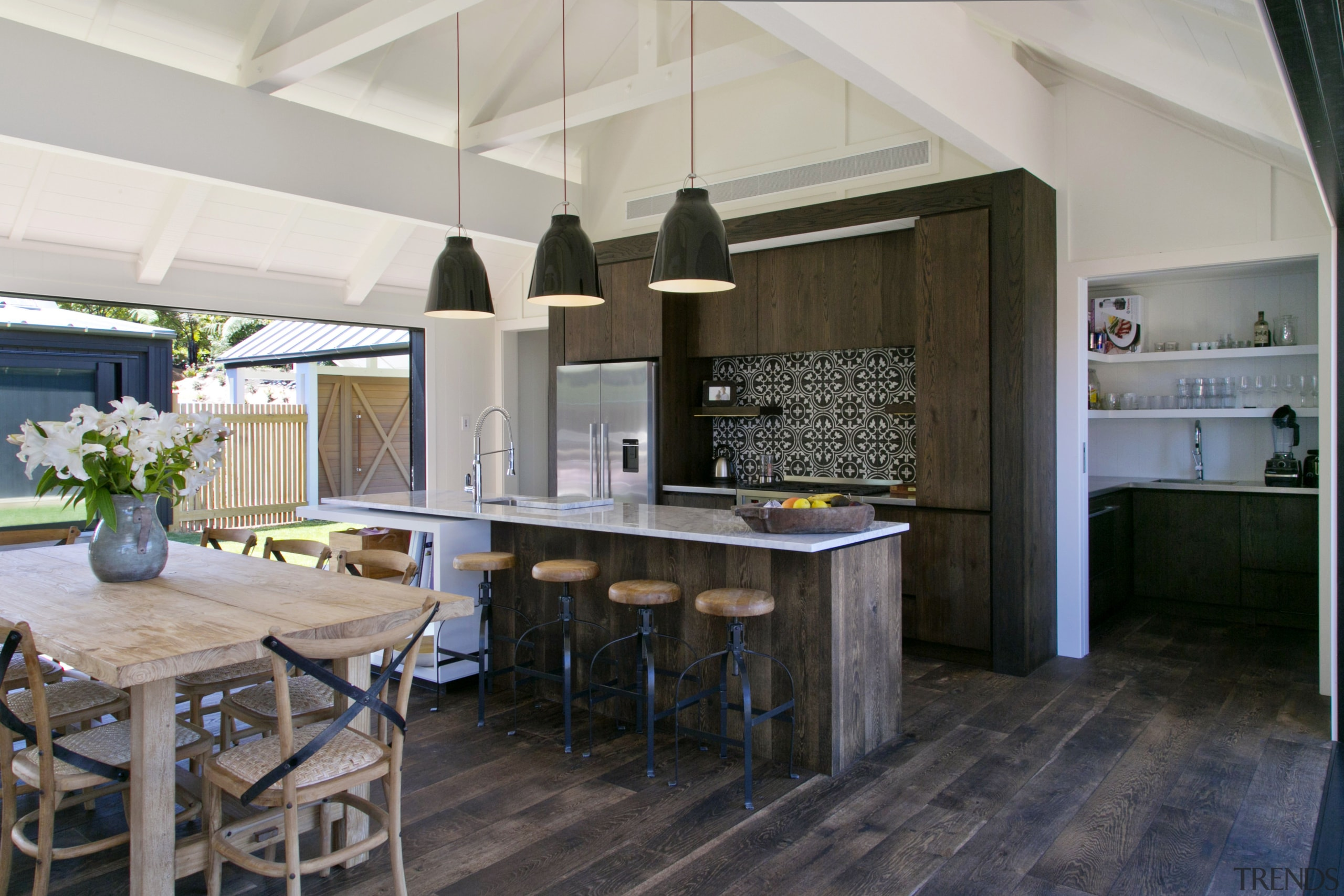 The pantry in this kitchen is designed to countertop, interior design, kitchen, real estate, gray, black